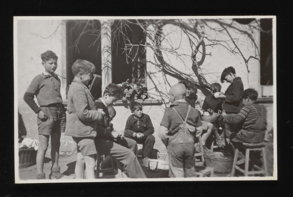 Young French boys and Jewish refugees in hiding gather outside the La Hille children's home.    Pictured on the far left is Paul Schlesinger.