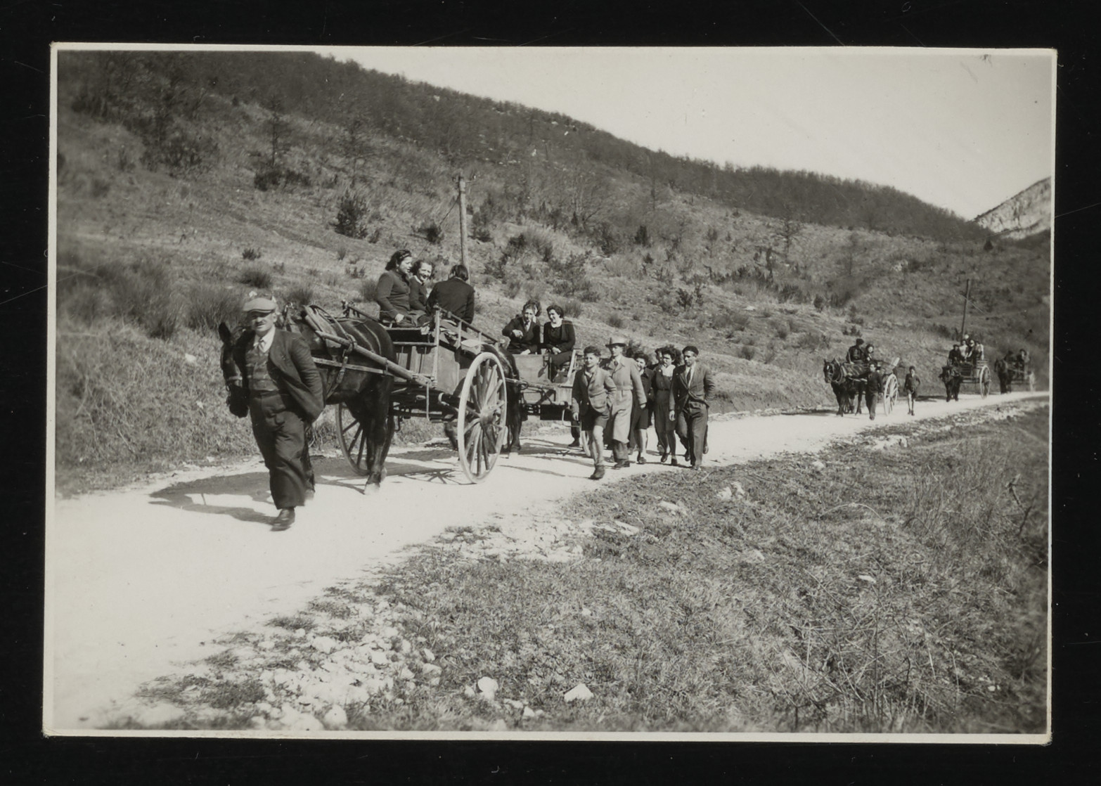 People travel to the Kagi wedding in La Hille children's home by horse drawn carts and by foot.