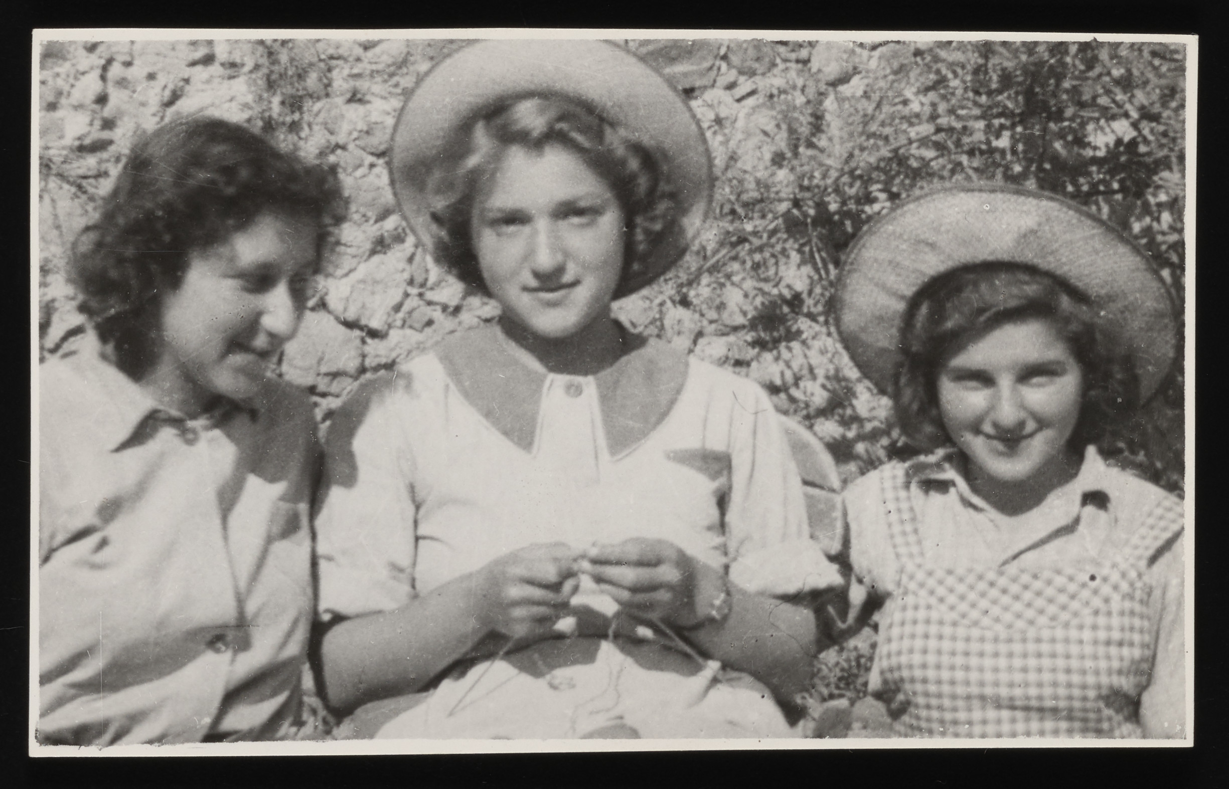Close-up portrait of three teenage girls in the La Hille children's home.  Pictured left to right are Inge Helft, Lixie Grabkowicz, and Dela Hochberger.