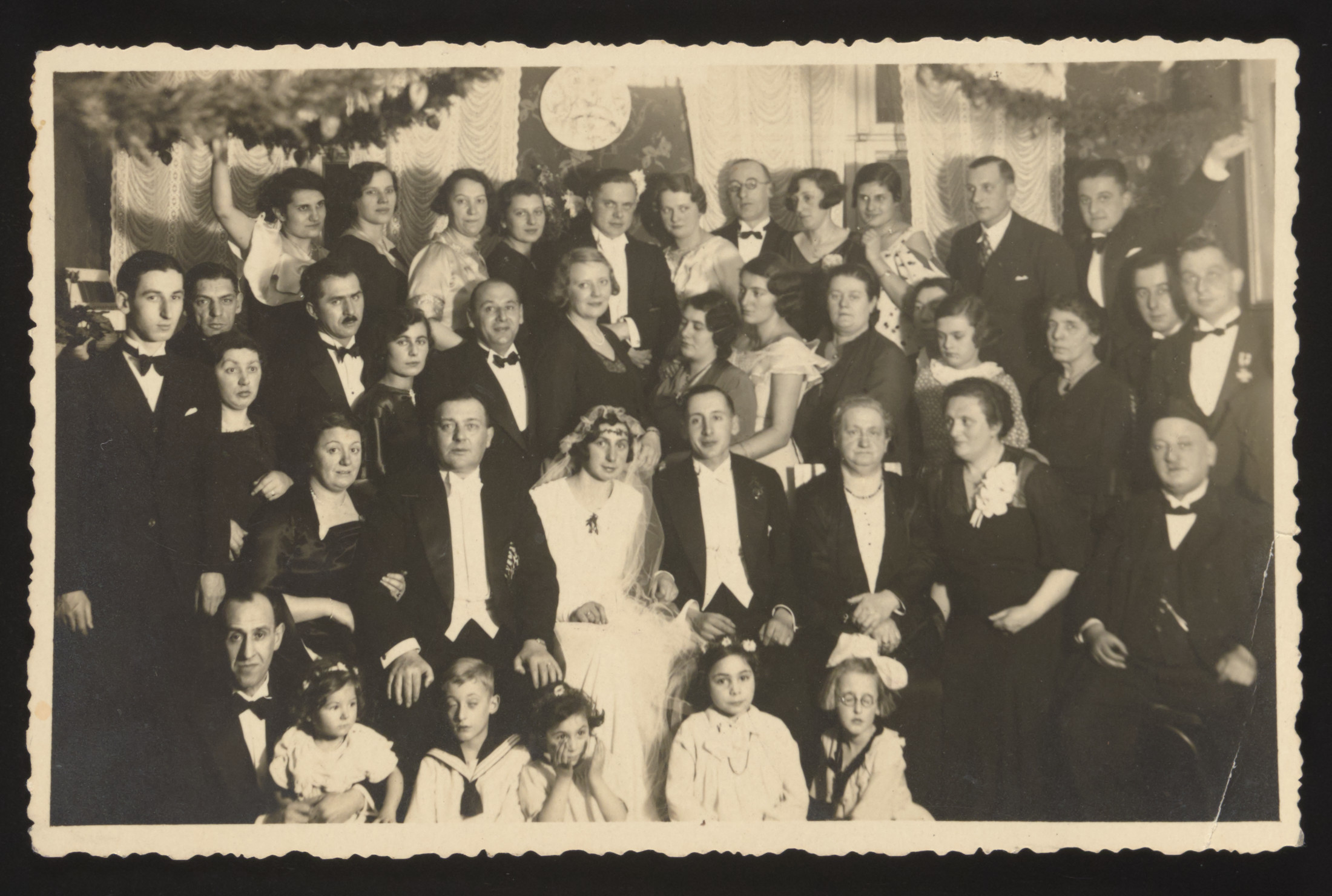 Friends and family celebrate the wedding of a member of the Isaacsohn family.  Rolf Isaacsohn is standing on the left.
