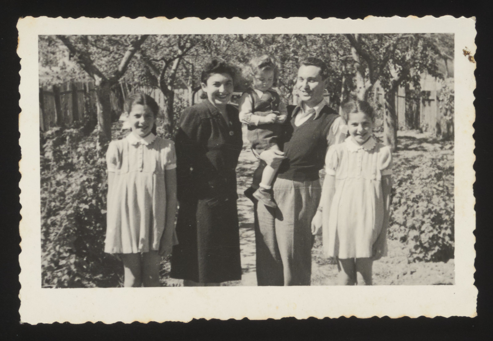 The Csengeri family poses together in a garden after the war.  Pictured are Rosie and Zvi Csengeri, their twin daughters Yehudit and Lea and son, Michael.