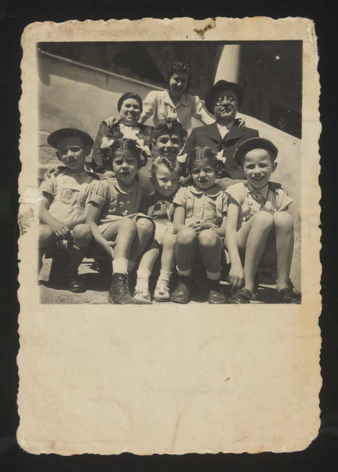 Twin sisters Yehudit and Lea pose with their maternal grandparents and cousins.  Their grandparents, Shmuel and Berta Engel, both perished in the Holocaust.