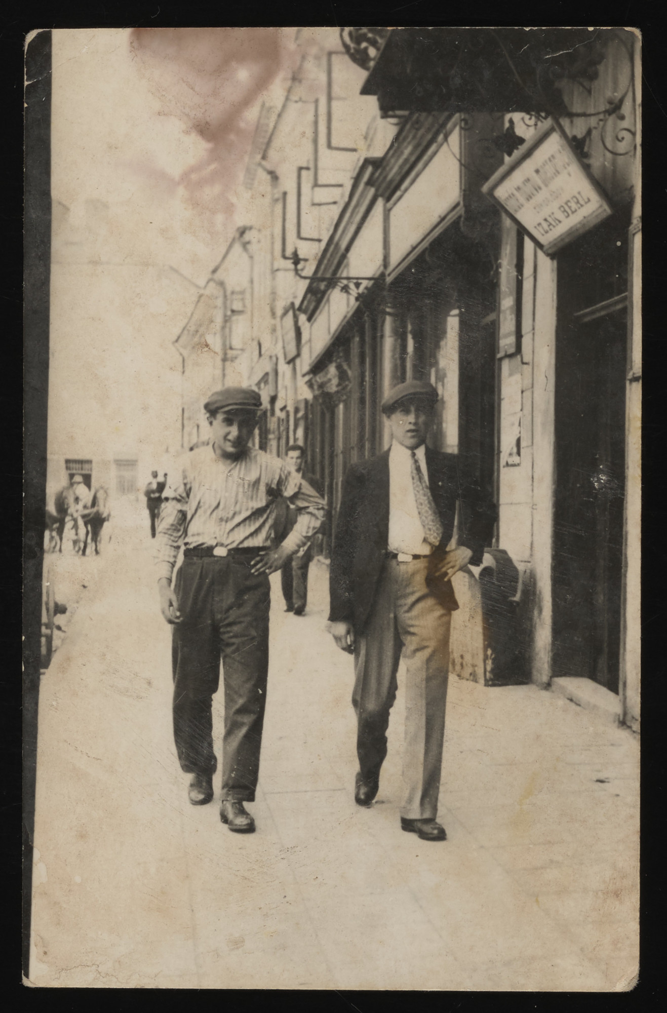 Two Jewish youths walk along a street in Rzeszow.  Pictured are Israel Mayer Stub and Yossel Weiss, friends who are visiting from Kolbuszowa.