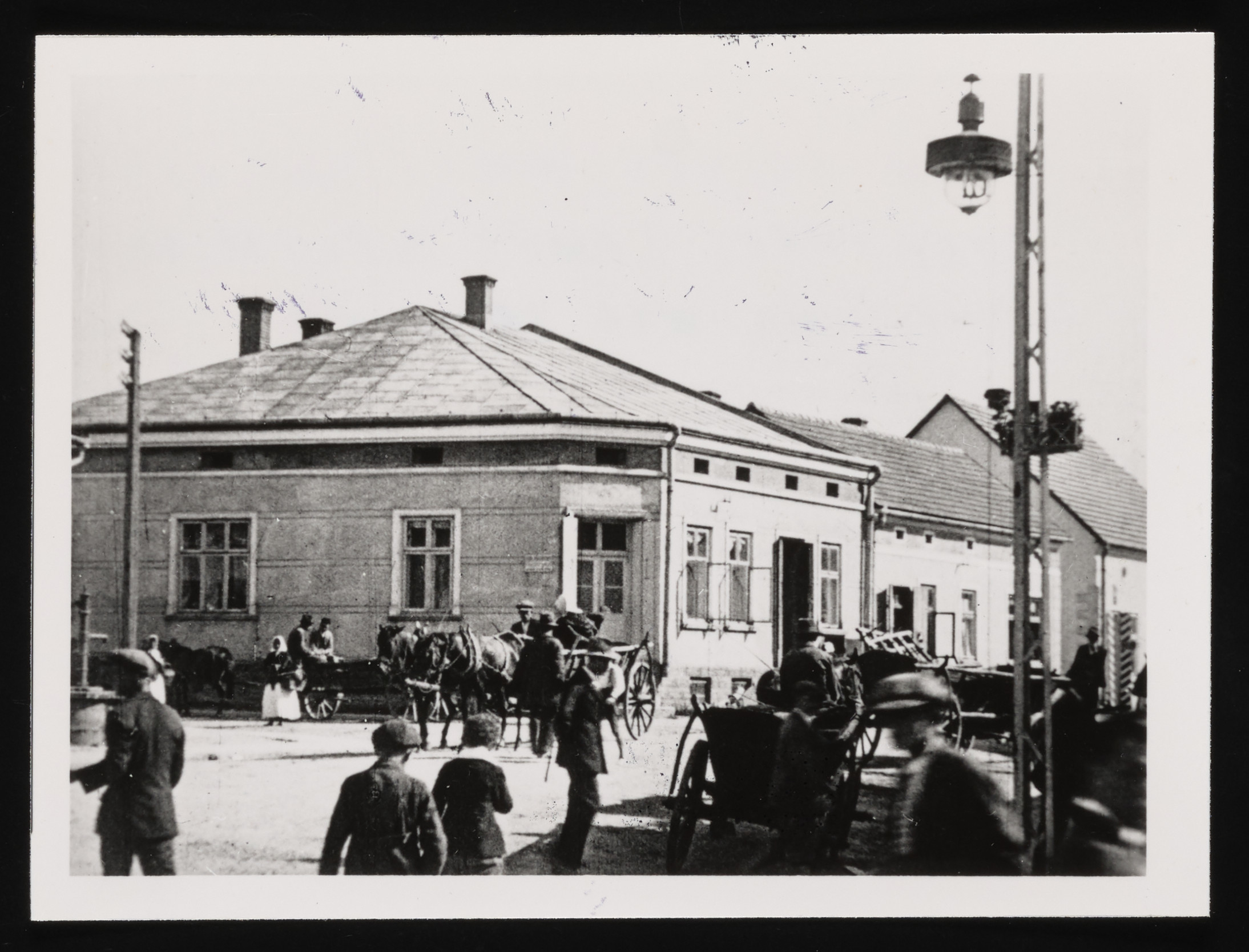 View of the central square in Kolbuszowa showing one of the three street lights that illuminated the town.