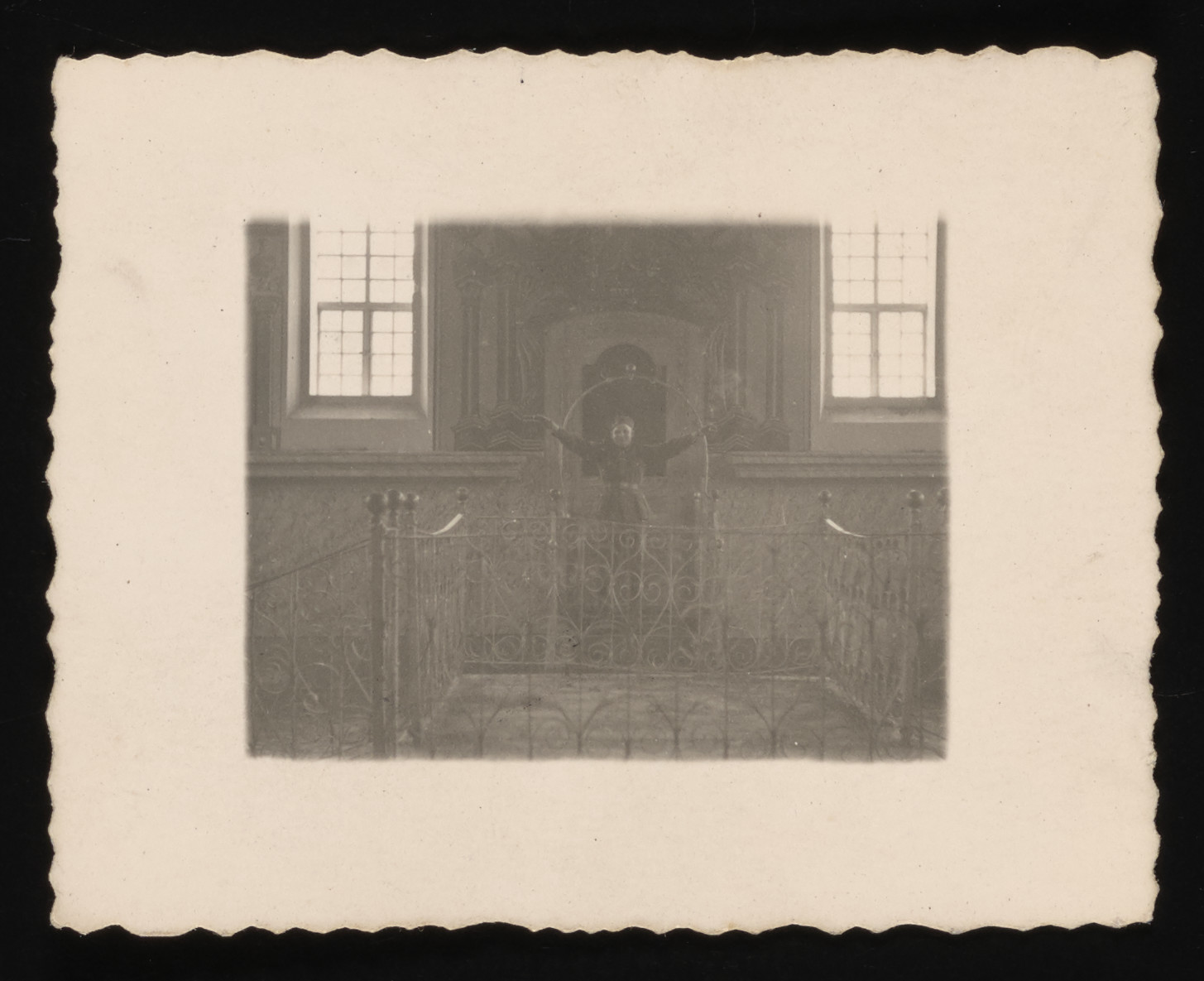 A German soldier pretends to preach from the bimah [podium] in the Kolbuszowa synagogue.