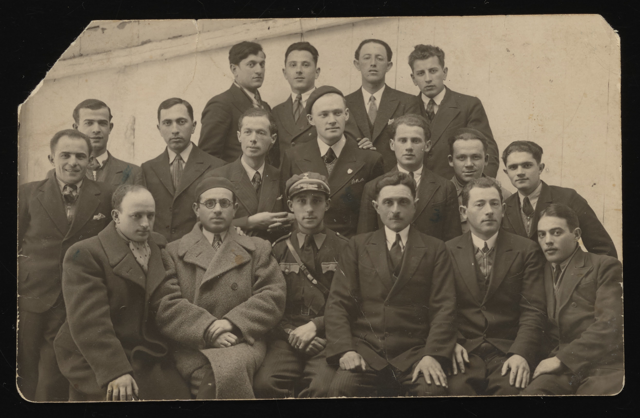 Group portrait of the members of the Zionist group, Brit Trumpeldor, in Kolbuszowa.    Among those pictured are Pasiek Rappaport (front row, left) who later became the second chairman of the Jewish council in Kolbuszowa; and his brother Yossel Rappaport (middle row, center wearing a beret) who later became the head of the Jewish police in the ghetto.