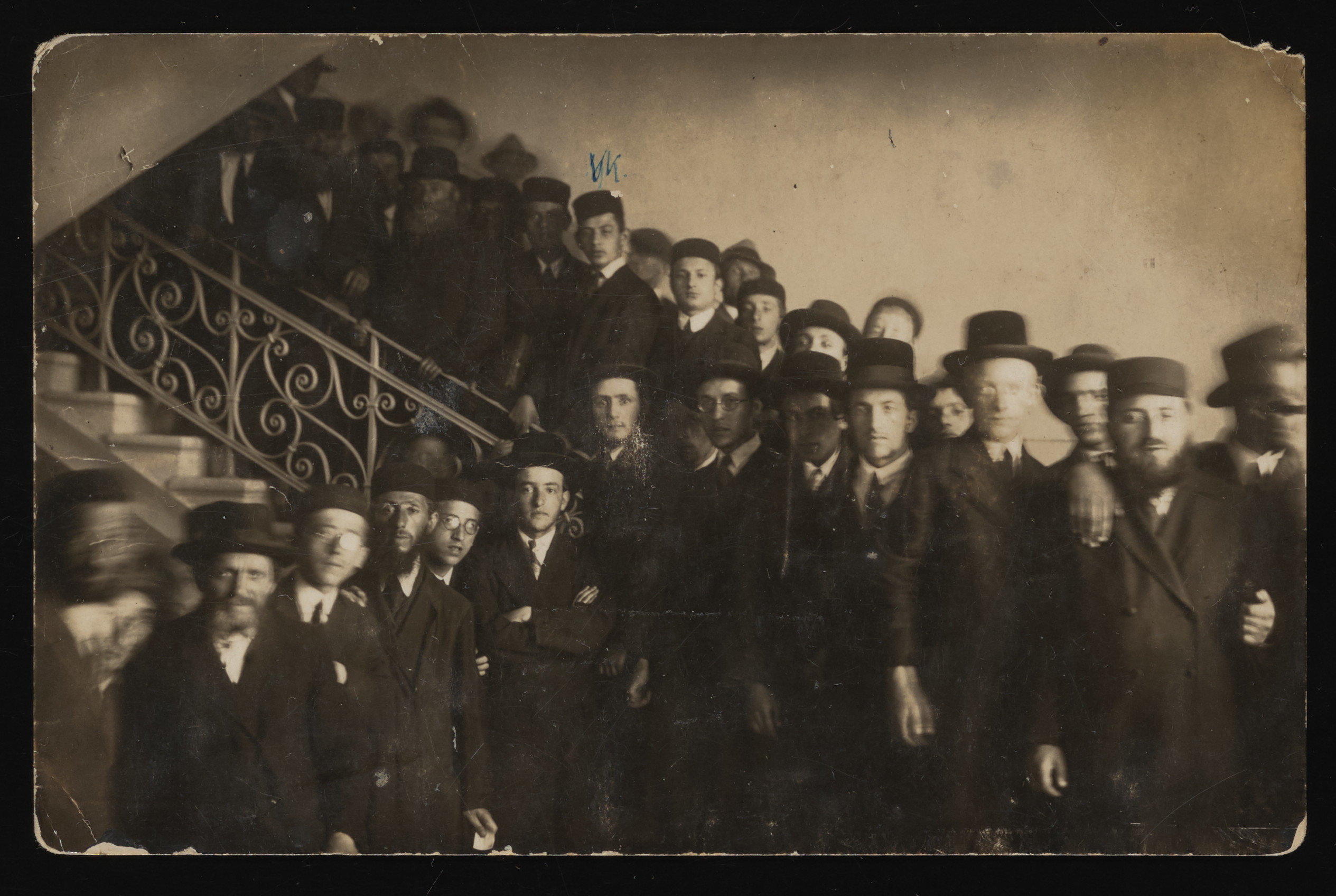 """Members of a yeshiva in Lublin pose on a staircase.  Pictured under the """"xx"""" is Moshe Kornfeld, the future husband of Liba Saleschütz."""