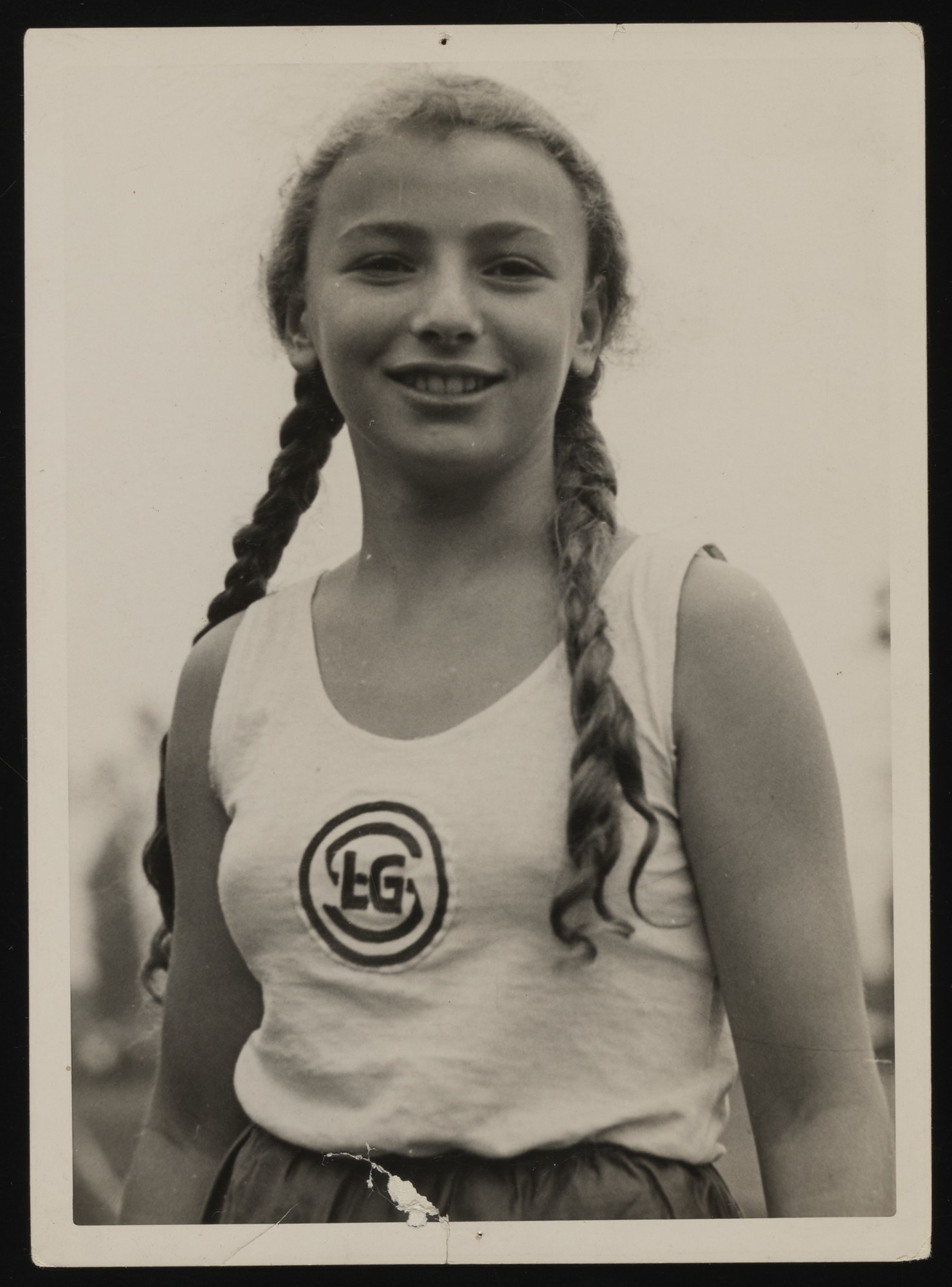 Close-up portrait of Gertrud Goldschmidt, a student from the Lenore Goldschmidt School, during a track and field event. She is also the daughter of the founder of the school, Lenore Goldschmidt.