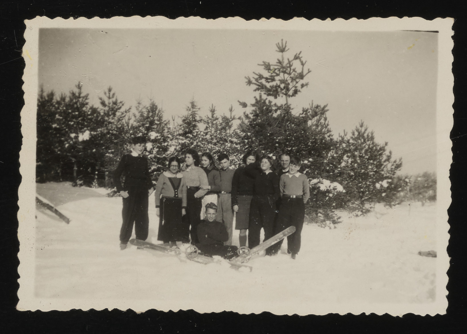 Group portrait of Jewish youth hiding in Le Chambon stand in the snow.
