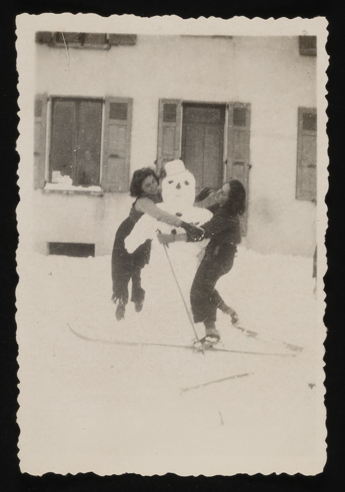 Two Jewish girls who are lhiding in Le Chambon build a snowman.  Pictured are Lili Braun (left) and Liesel Kaufmann (now Elizabeth Koeing, right).