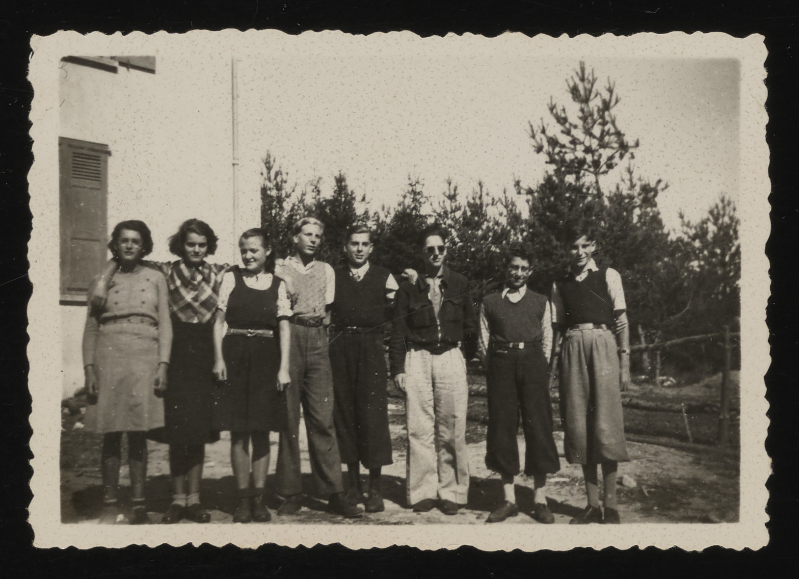 """Group portrait of Jewish youth near the """"La Guespy"""" children's home in Le Chambon."""