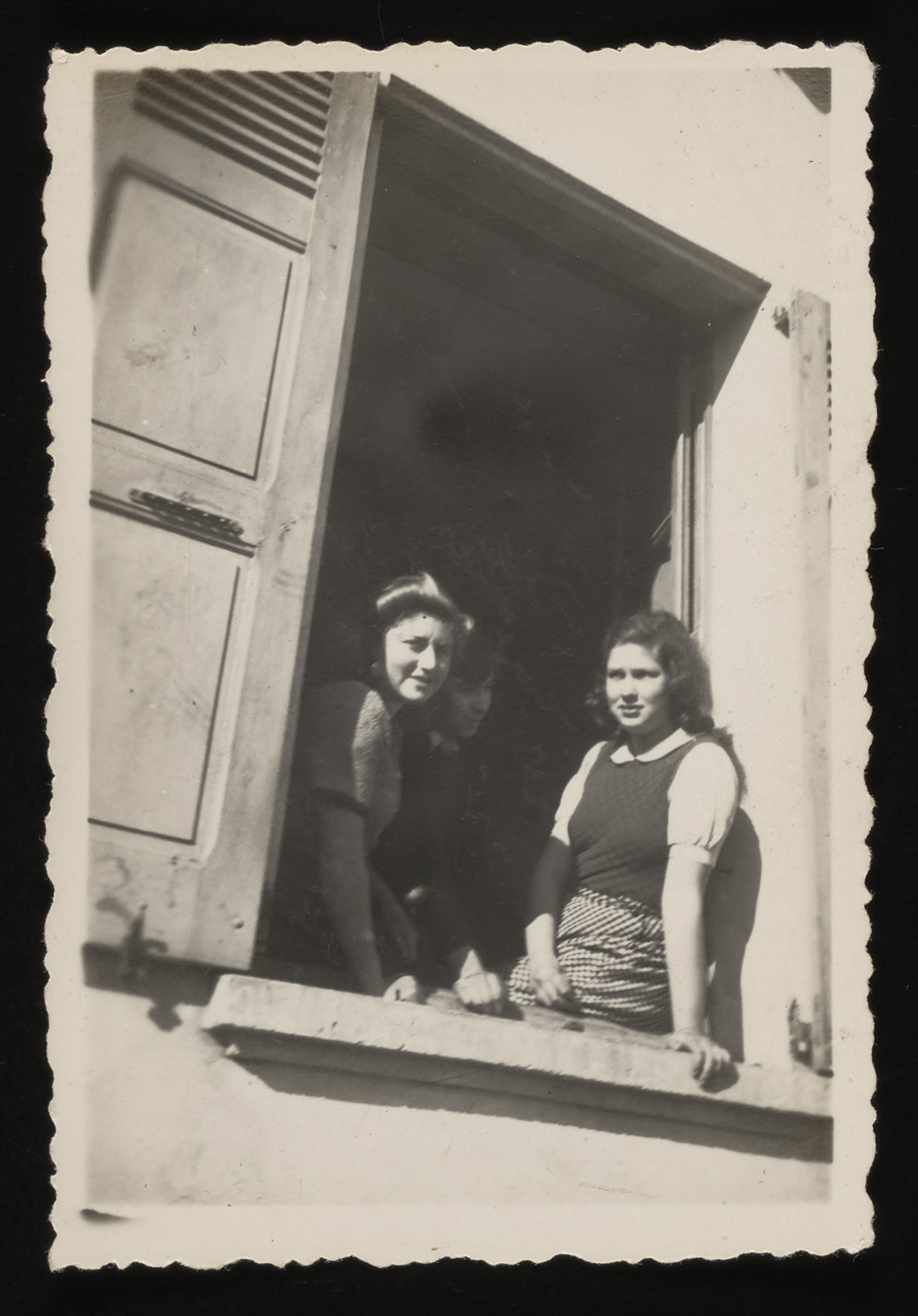 Three Jewish youths pose in the window of their residence while hiding in Le Chambon.