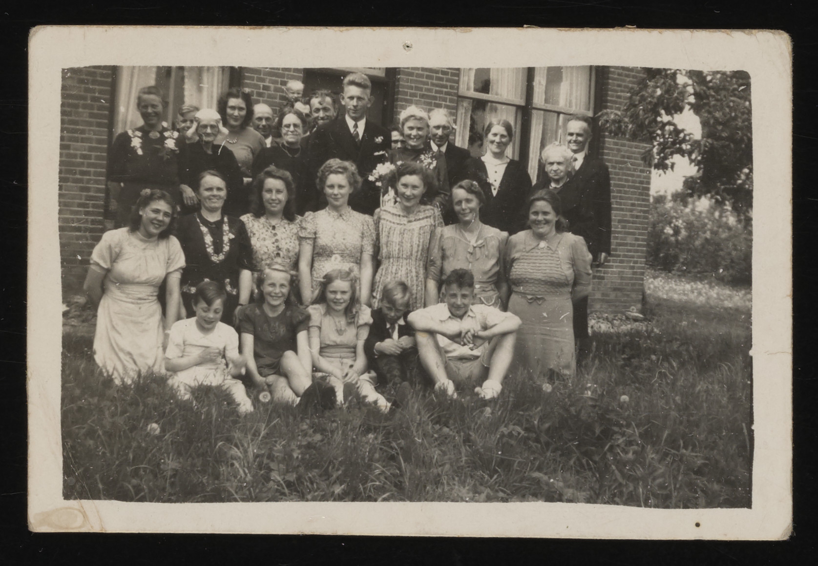 Group portrait of a Dutch family and a Jewish boy hiding there.  Pictured are the family of Folkert Kuperus, a member of the Dutch underground.  Leo Serphos is pictured in the front row, far right.