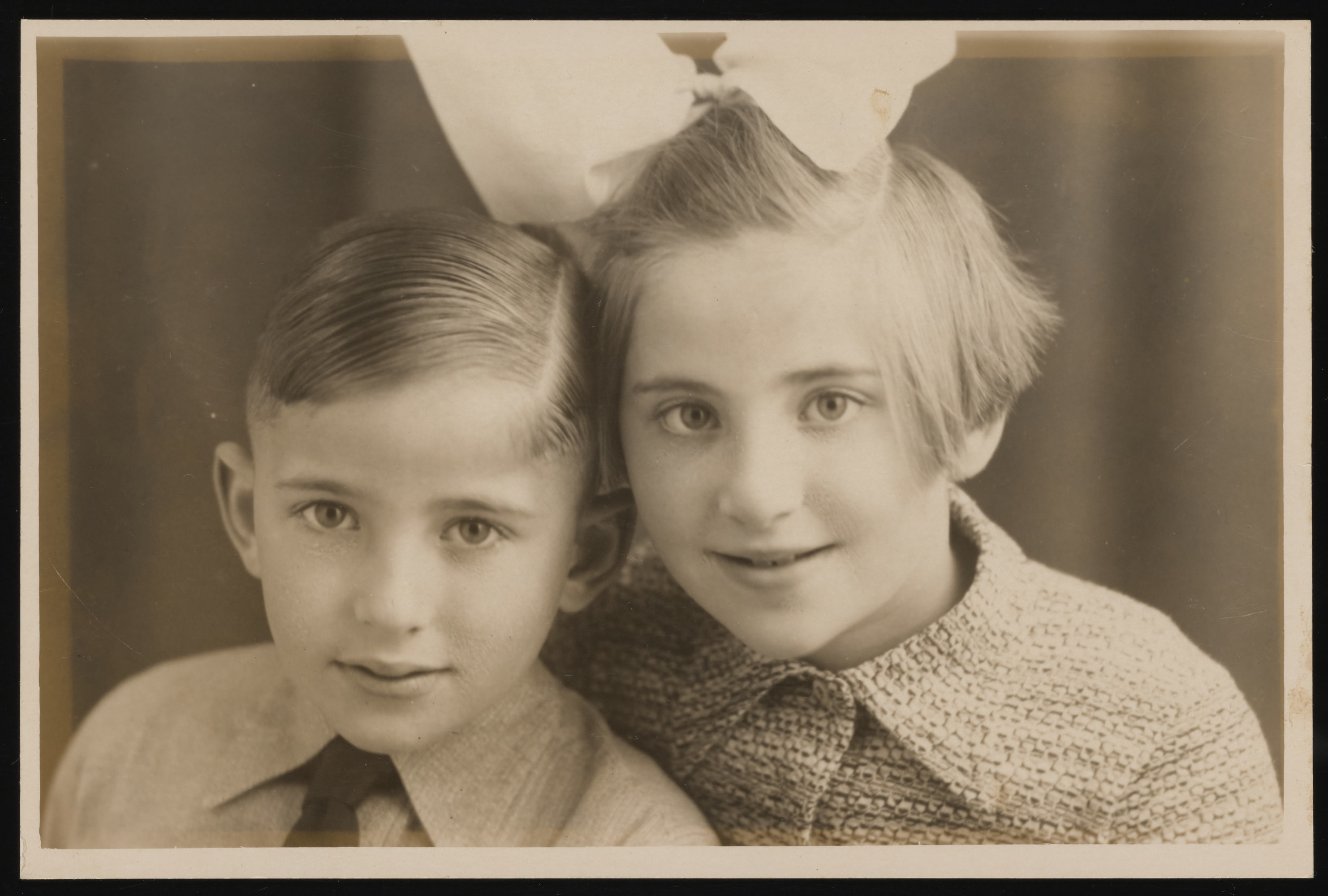 Close-up portrait of a Dutch Jewish brother and sister.  Pictured are Leo and Bertie Serphos.