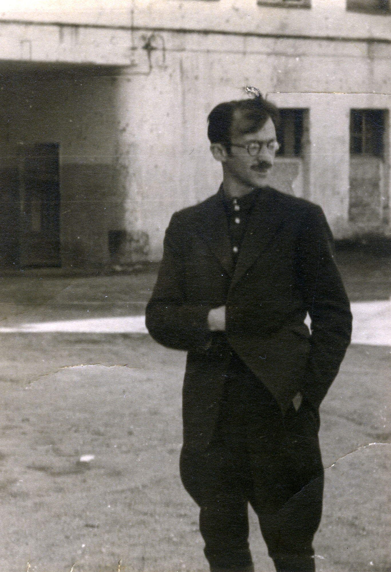 Avraham Sutzveker stands in the ruins of the Vilna ghetto.