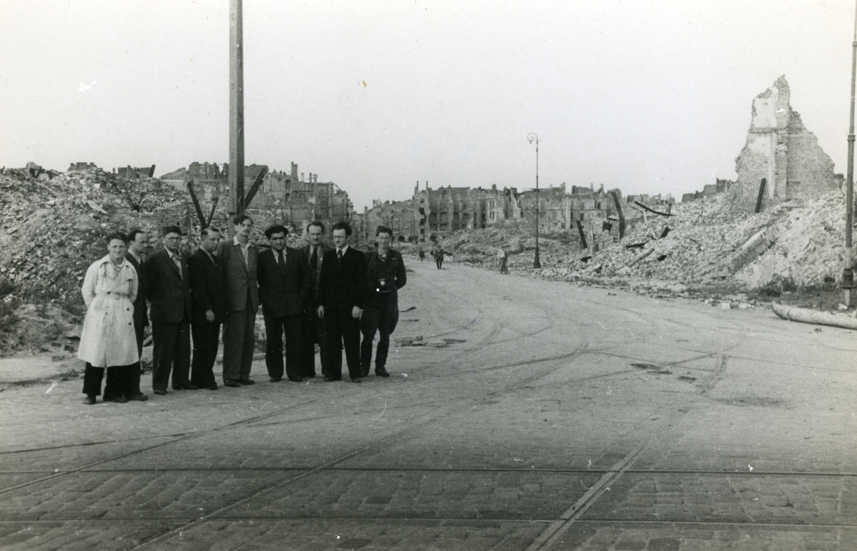 Group portrait of Polish Jewish intellectual and cultural leaders standing amidst the ruins (possibly in the Warsaw ghetto).  Among those pictured are Professor Avram Novershtern (fourth from the left) and Yitzkah (Antek) Zuckerman (fifth from the left).   Novershtern survived the war and became a prominent Israeli Yiddish scholar.