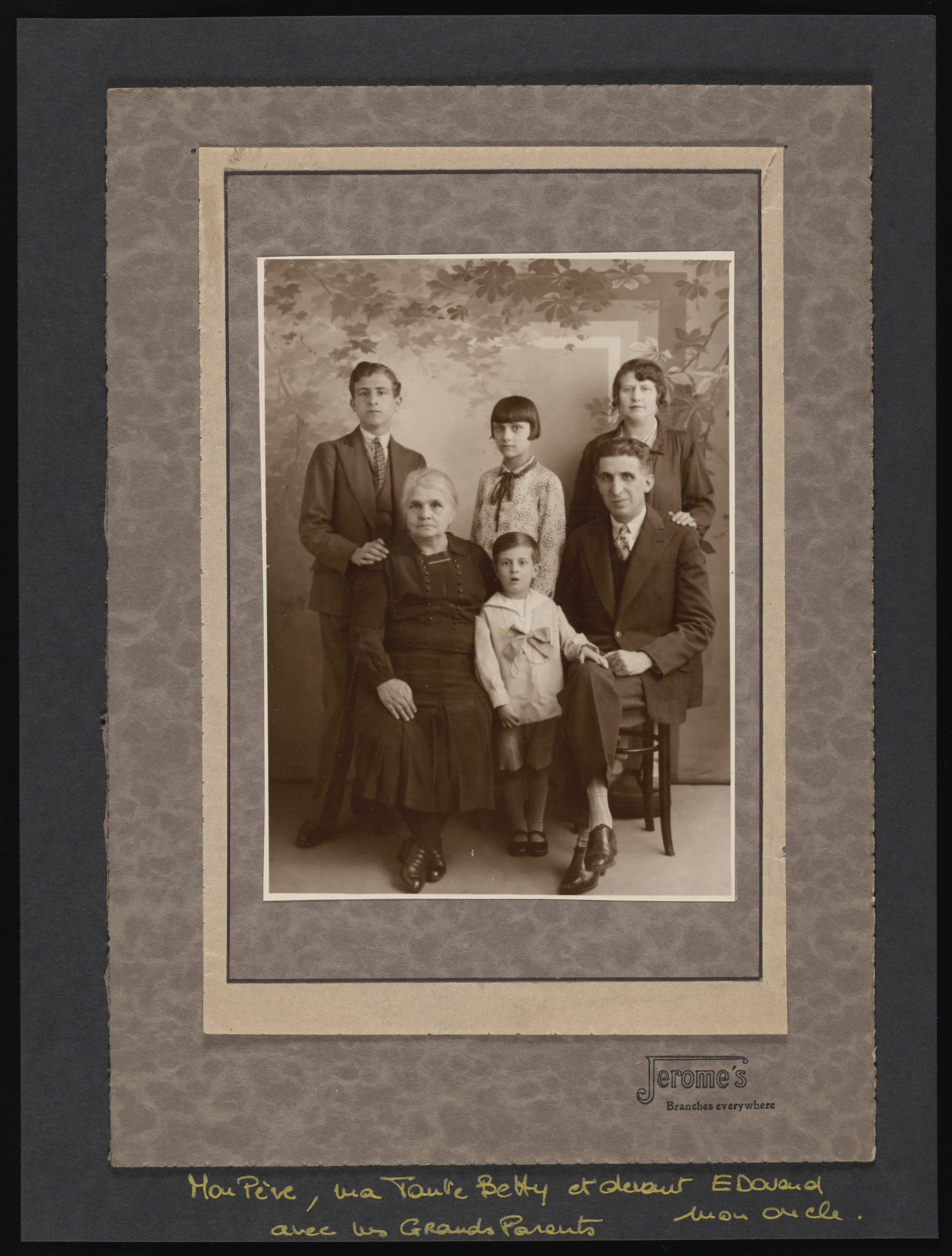 Studio portrait of the Arditti family, a Turkish Jewish family living on the outskirts of Paris.  Pictured in front are the maternal grandmother (maiden name Jaffe), Edouard, father.  Standing Jacques, Betty and mother.
