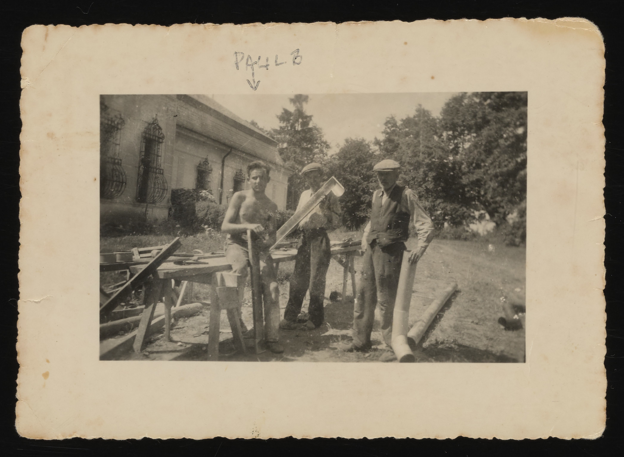 Three men work on a construction site in Szendro.  Pictured on the left is Paul Brunn, an apprentice roofer.  He was taken into forced labor and perished in the fall of 1944.