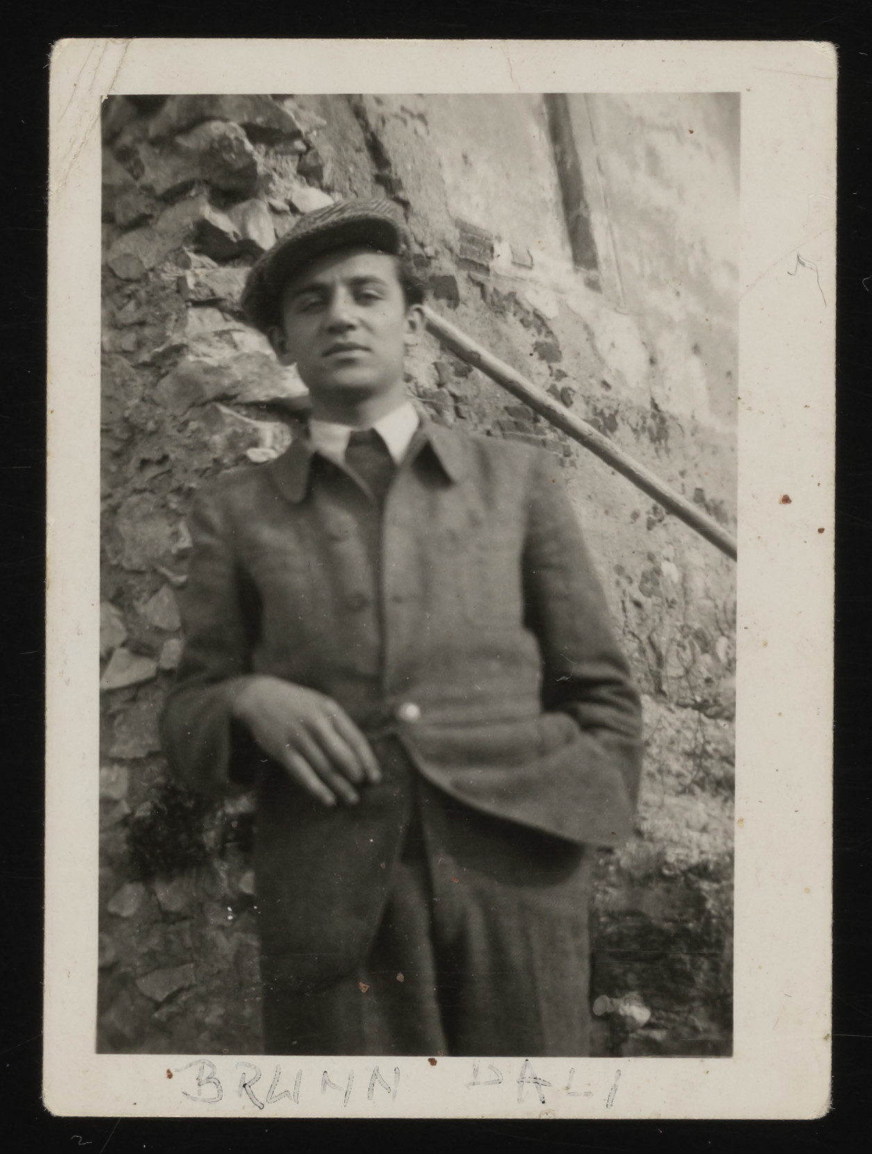 Paul Brunn leans up against a wall; soon afterwards he was conscripted for forced labor and perished in the fall of 1944.