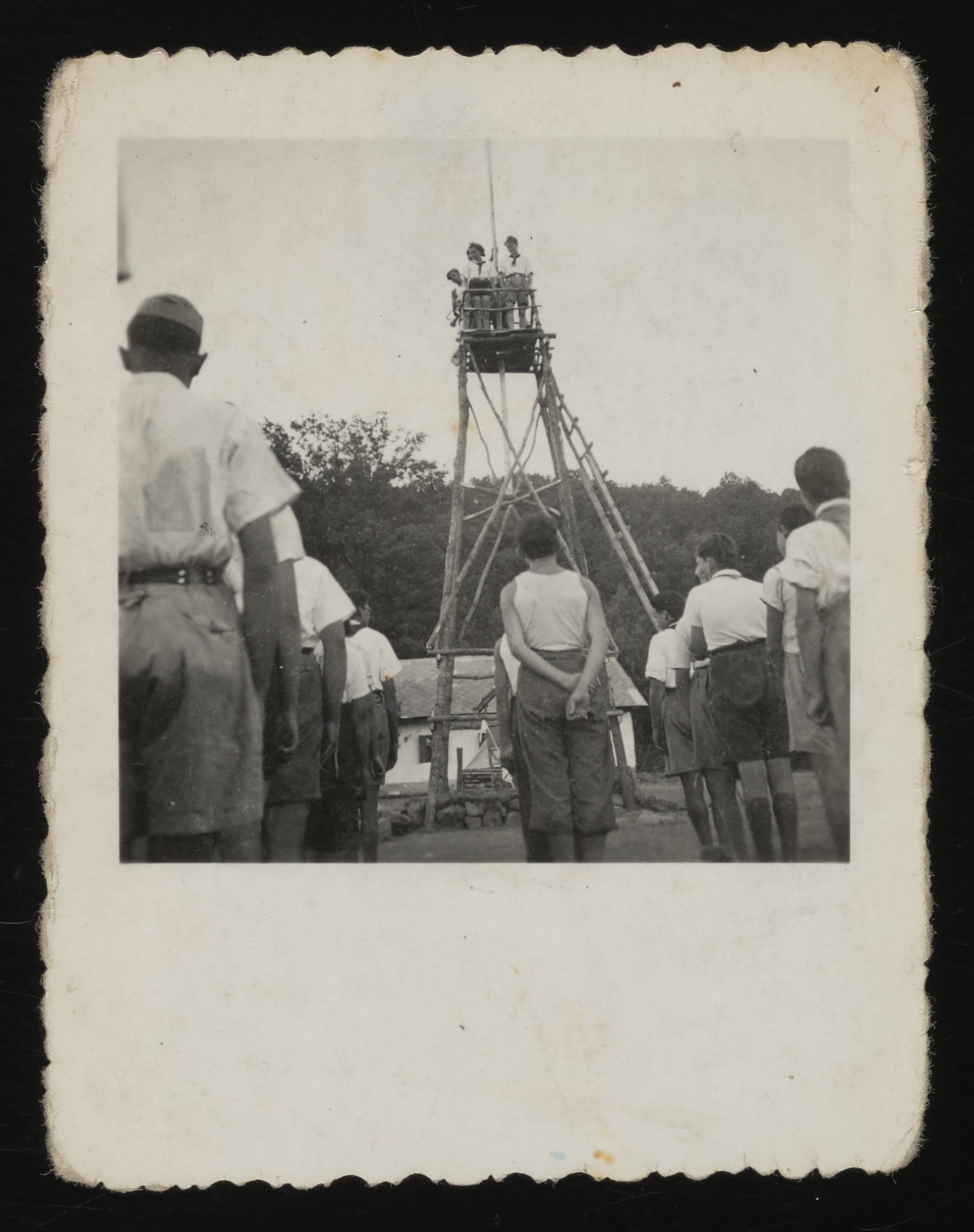 Hungarian Jewish teenagers climb a wooden tower in a Zionist summer camp.