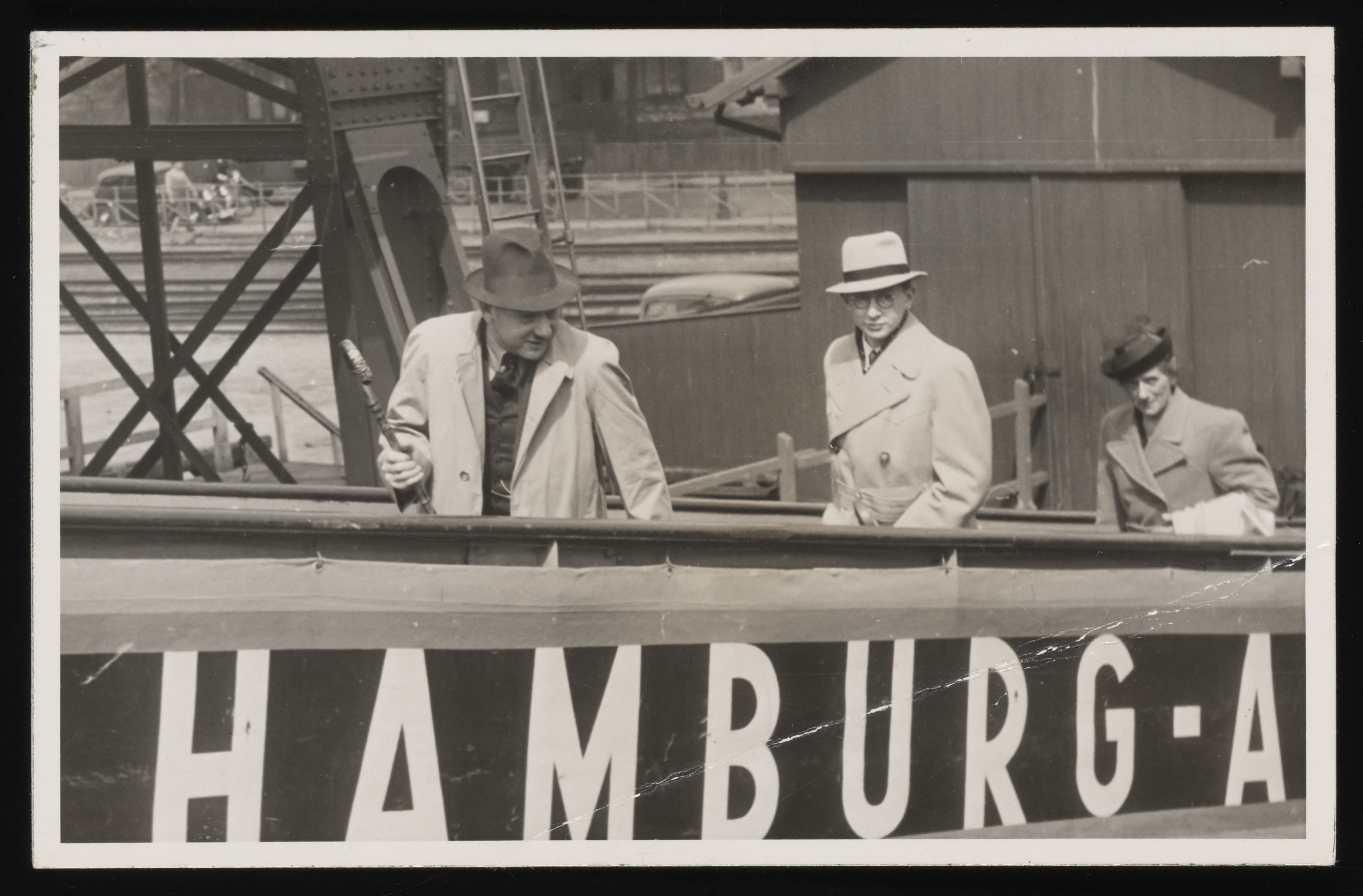 Members of the Dingfelder family board the MS St. Louis in Hamburg harbor.  Pictured from left to right are: Leopold, Rudi, and Johanna Dingfelder.