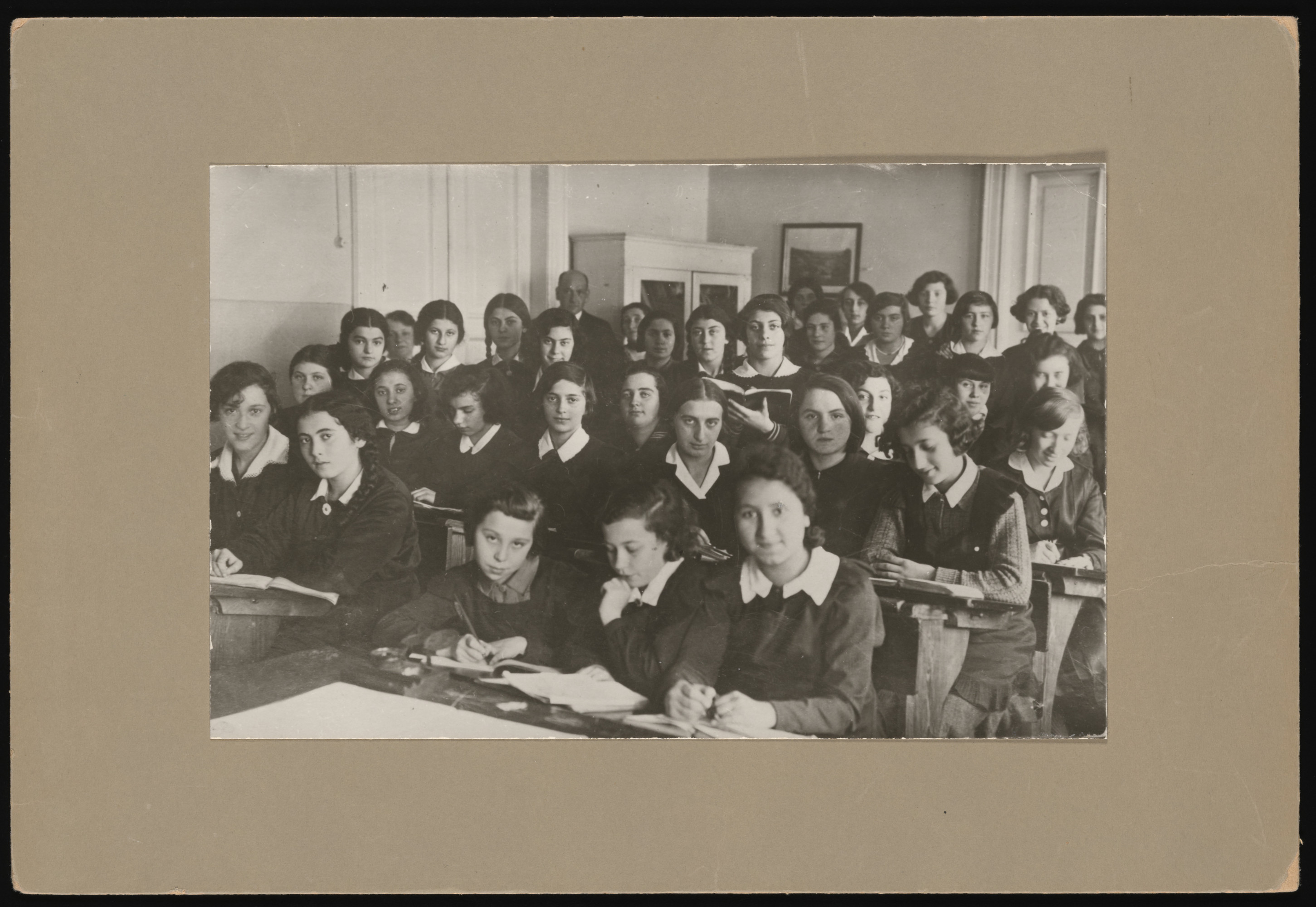 Girls in the Yehudyia Gymnasium in Warsaw.  Minna Friedland is standing directly in front of the male instructor.