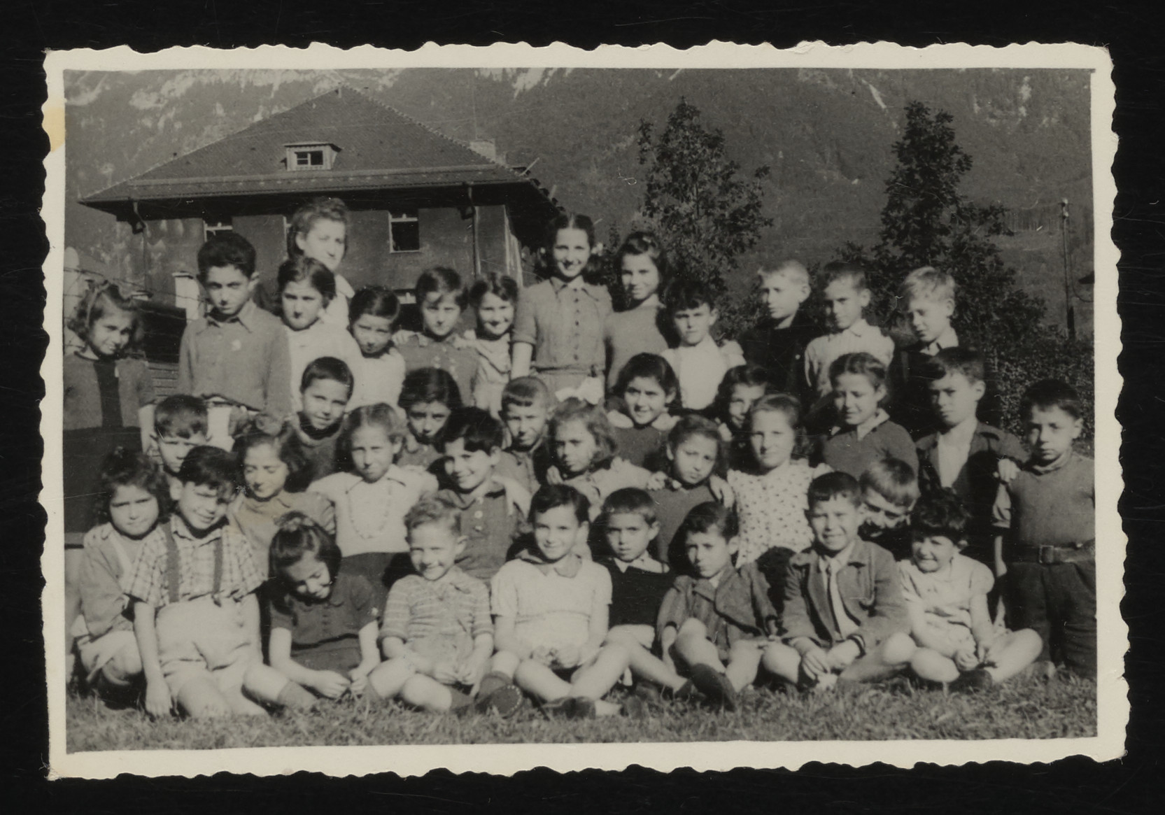 Group portrait of Jewish children in the Bad Reichenhall DP camp.  Among those pictured, eighth from the left in the top row, in the middle, is Cywia Perelmuter (now Sylvia Rozines).