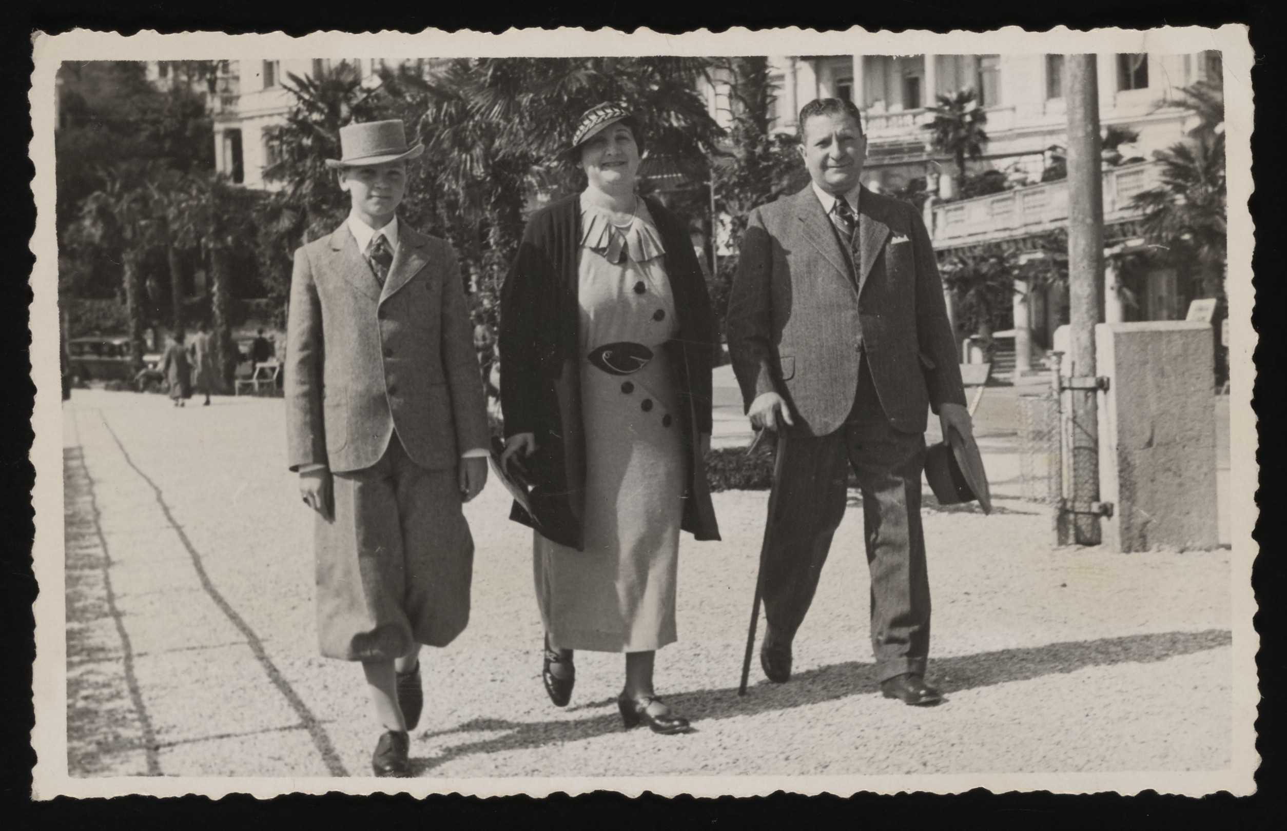 The Vogel family walks down a street while on vacation in Italy.  Left to right are Steven, Wilma and Odon Vogel.