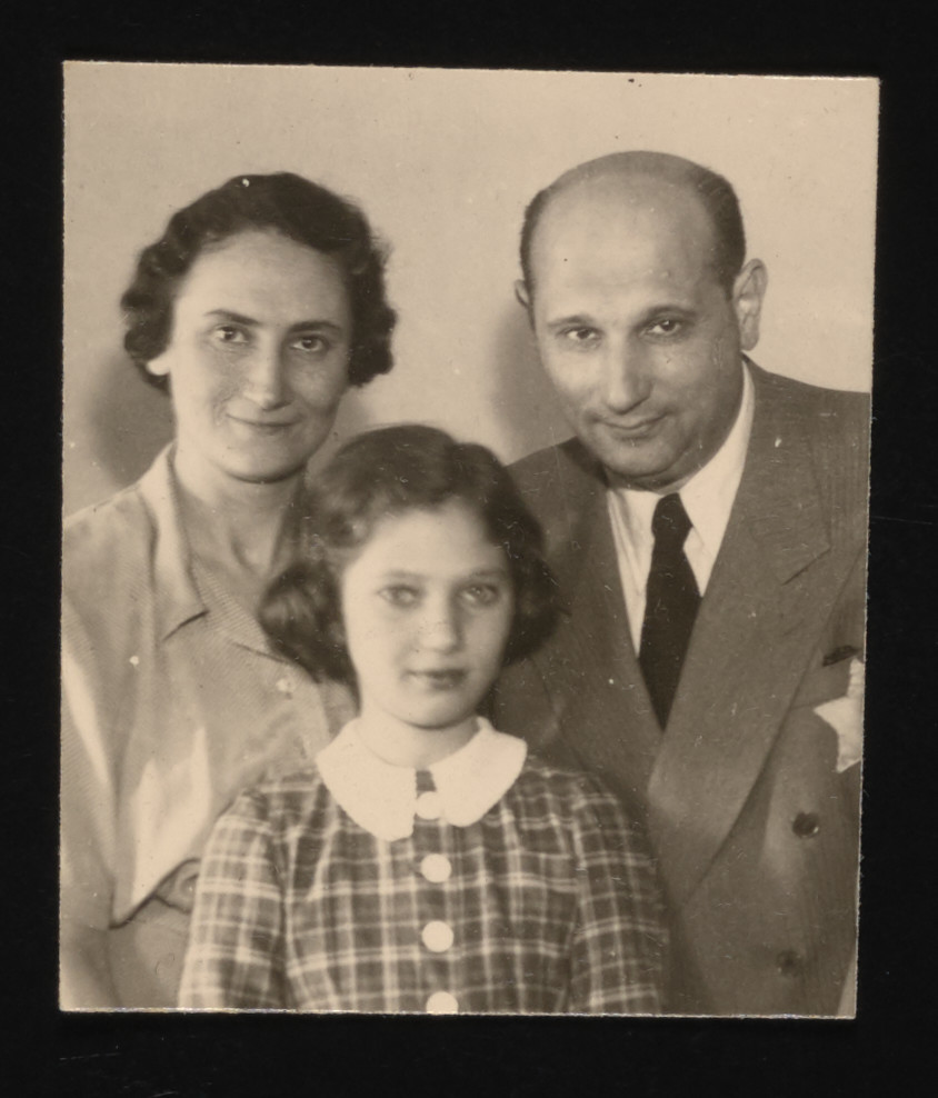 Family portrait of the Brust family under German occupation.  Pictured are Livia, Eva and Elek Brust, wearing a yellow star.