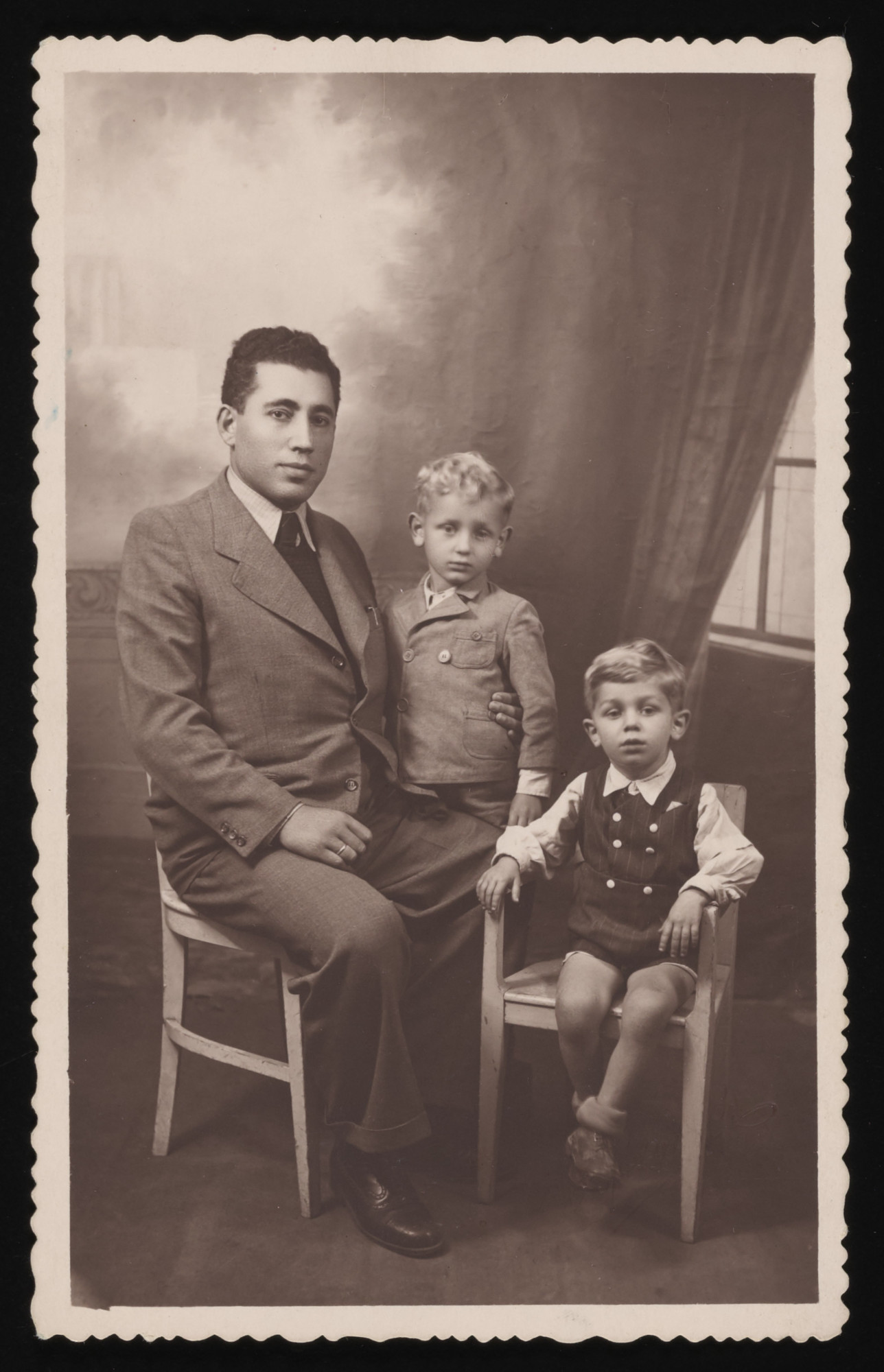 Studio portrait of Jewish rescuer Ben Zion Kalb with Itzhak and Alter Weinberg, two young orphans from Krakow that he helped smuggle into Slovakia.  The Weinberg boys then proceeded on to Hungary and were saved on the Kasztner Transport.