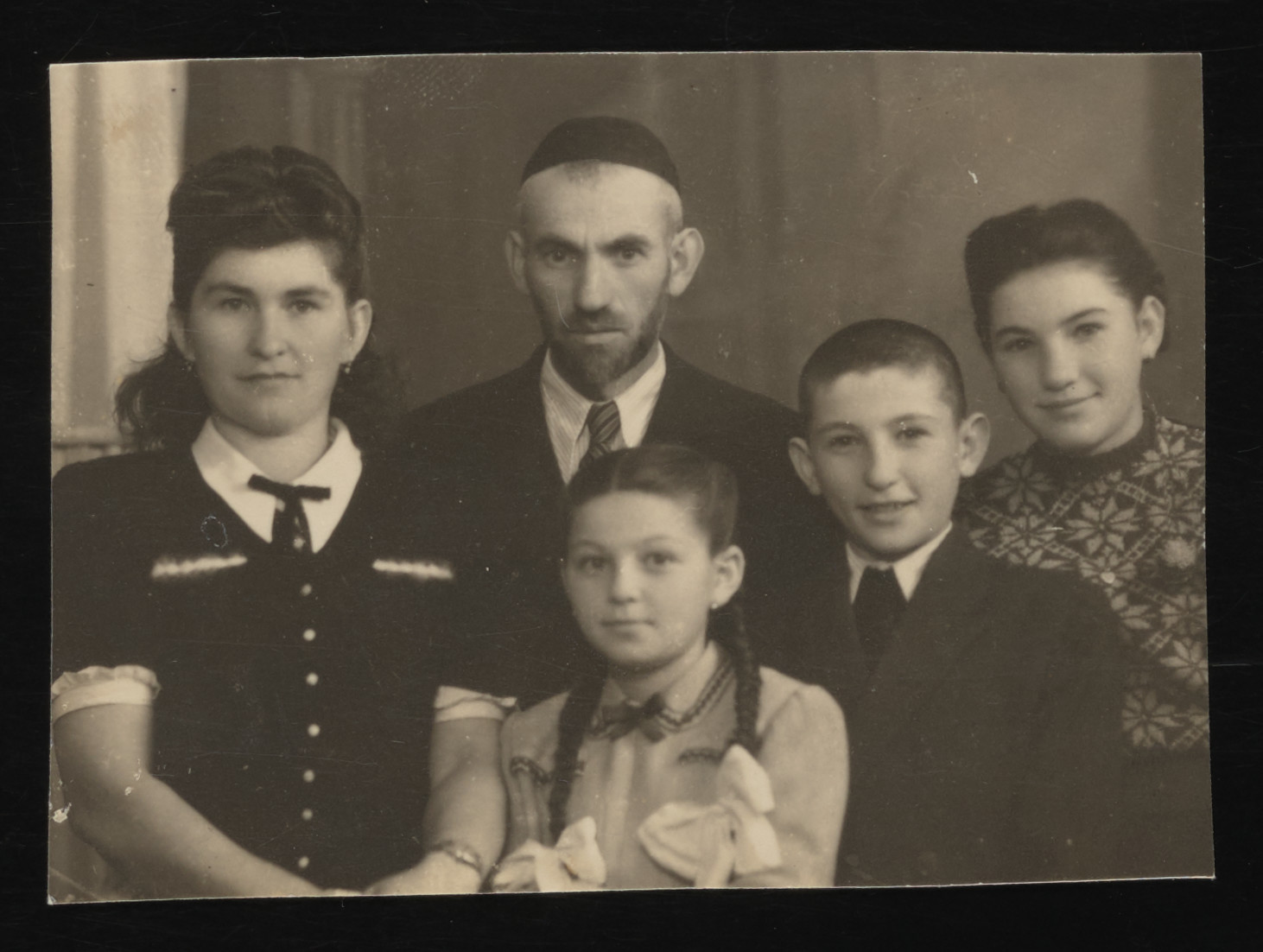 Postwar photograph of the Spitzer family.  Pictured from left to right are Fany, Anton, Lily, Nathan and Sara.