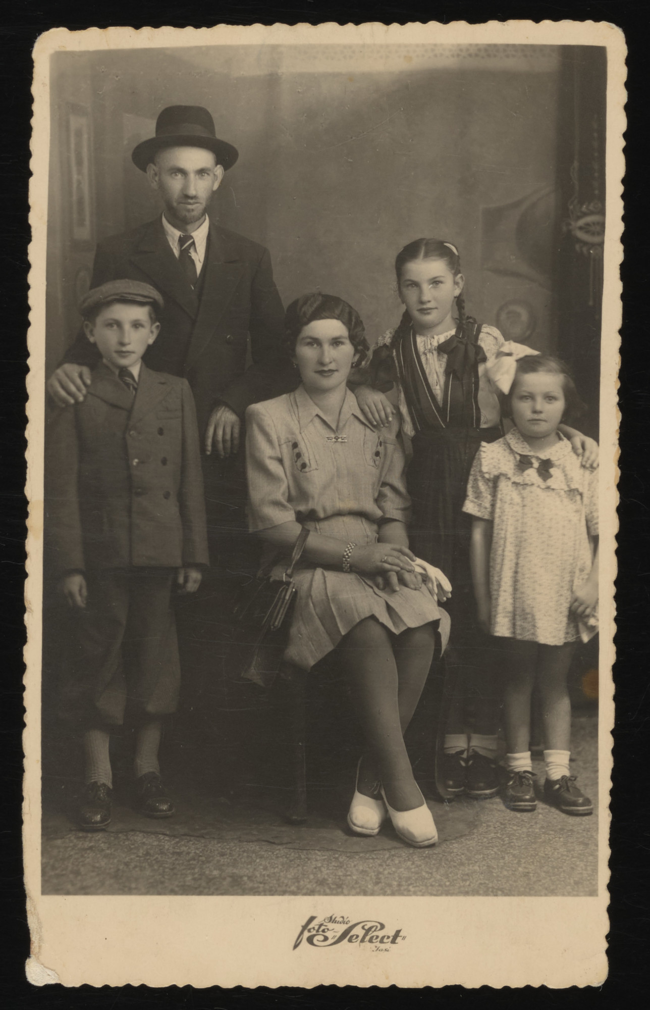 Postwar studio portrait of the Spitzer family.  Pictured from left to right are Nathan, Anton, Fany, Sara and Lily Spitzer.