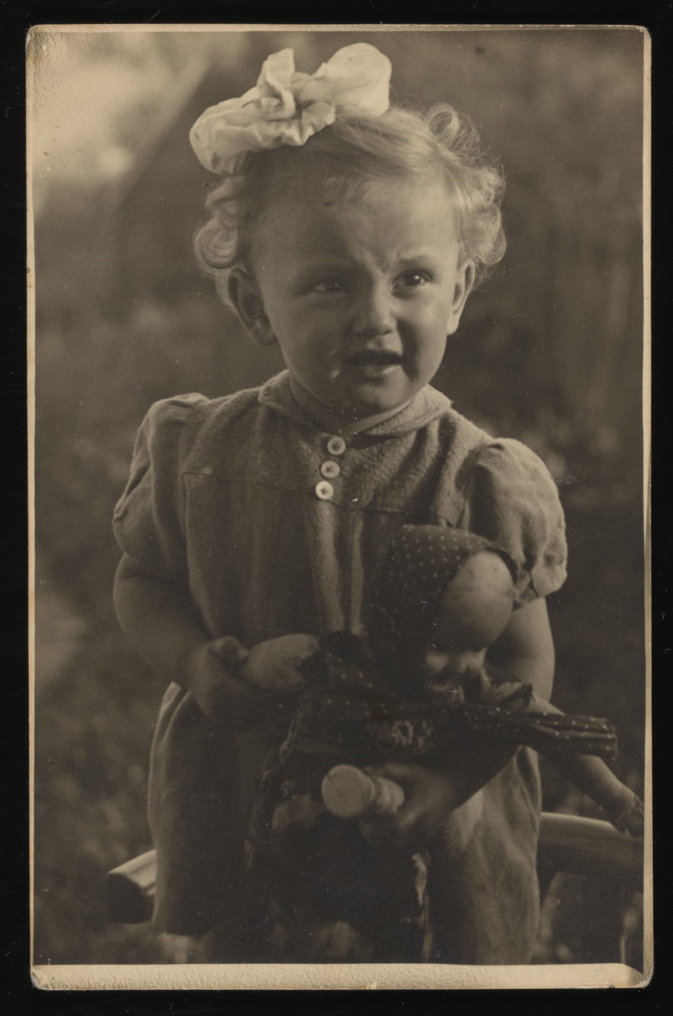 Studio portrait of Leiba Gruber (cousin of the donor) she was killed with her mother in 1943 at the age of four.