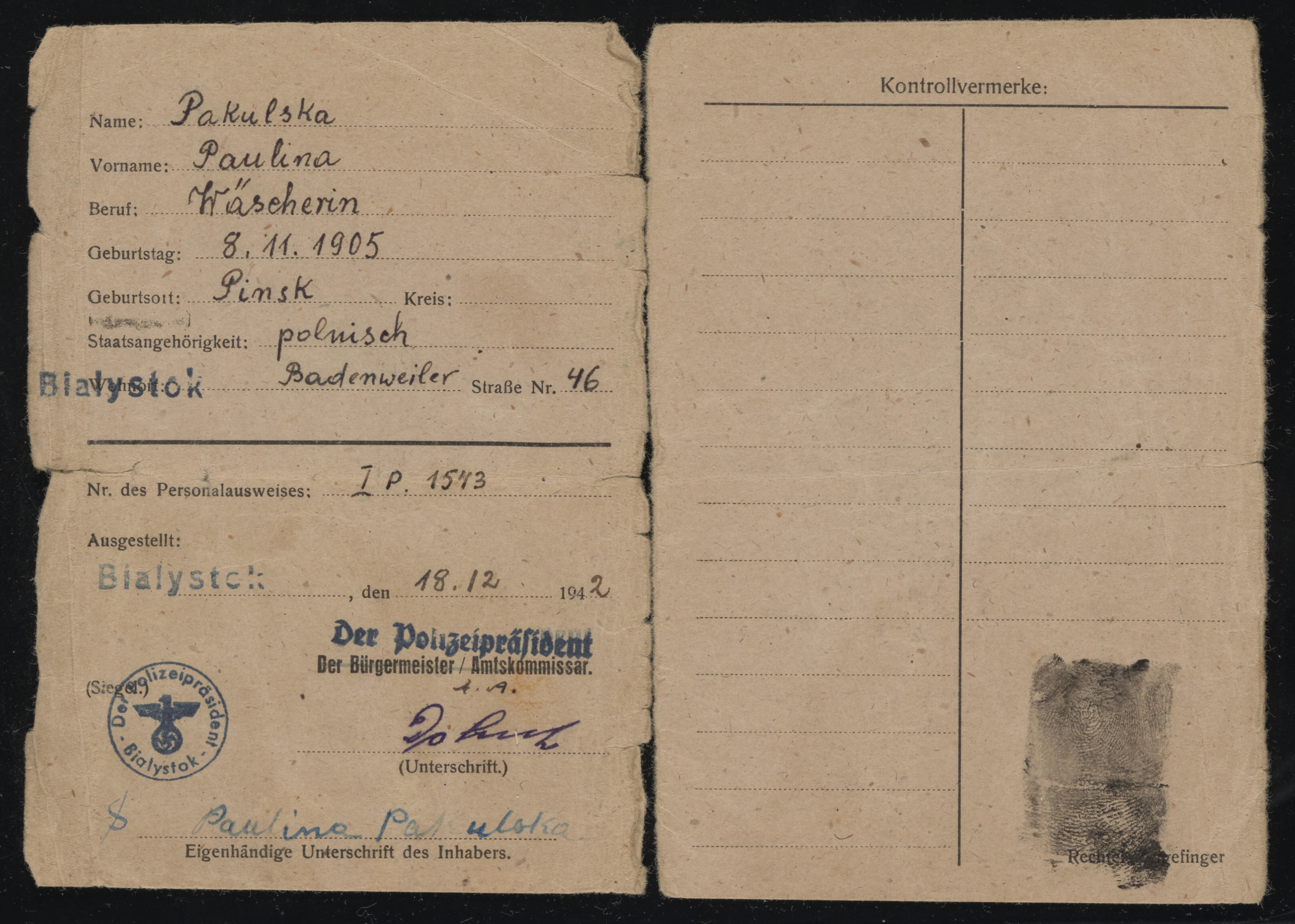 Work permit issued to Bela Rozenszajn, who was living in hiding under the name of Paulina Pakulska.  In the document she is identified as a laundress, born on November 11, 1905 in Pinsk.