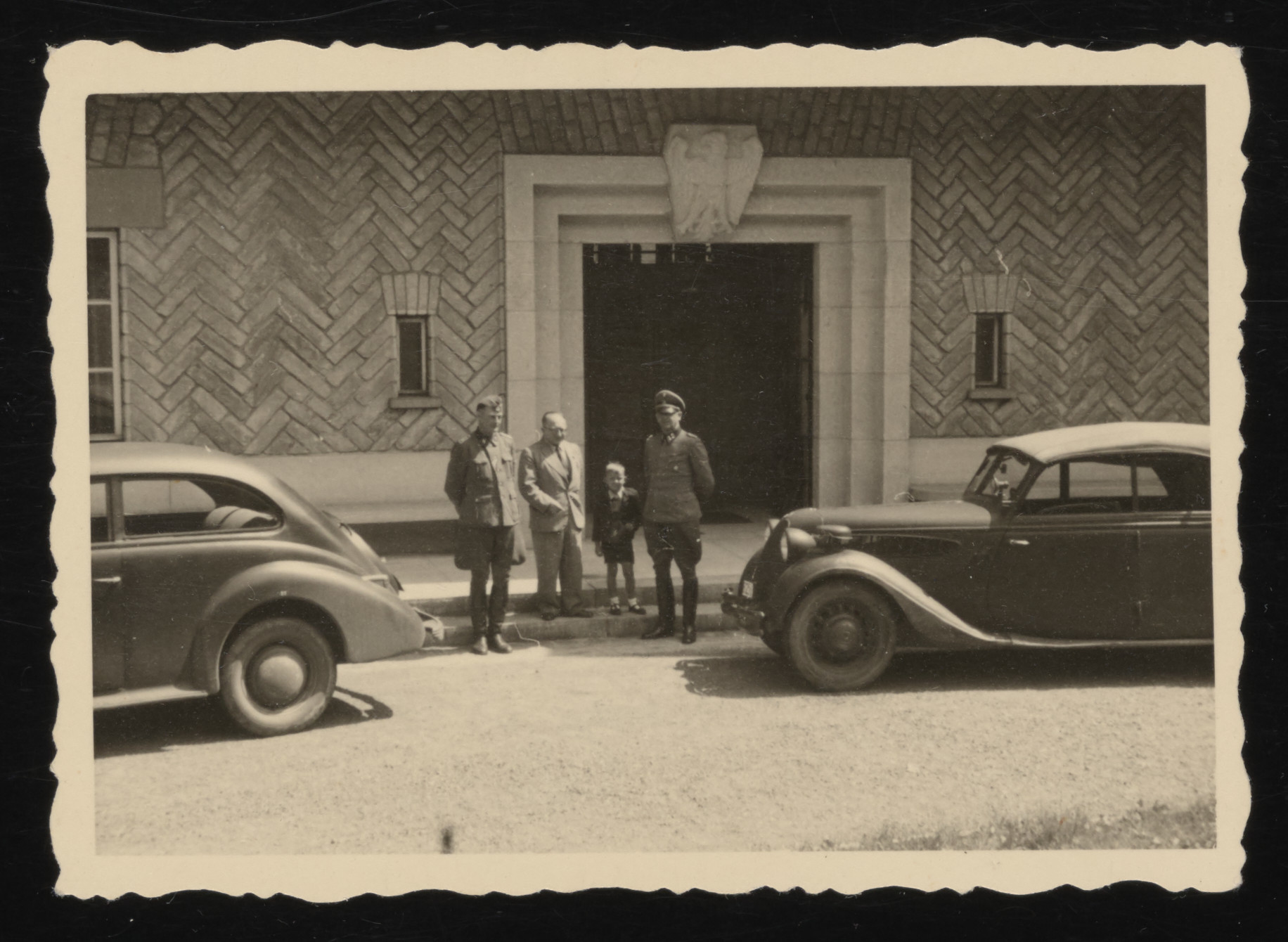 Dr. Eduard Wirths and Prof. Carl Clauberg visit the presidential palace in Wisla.    Standing between them is one of the sons of Rudolf Hoess.