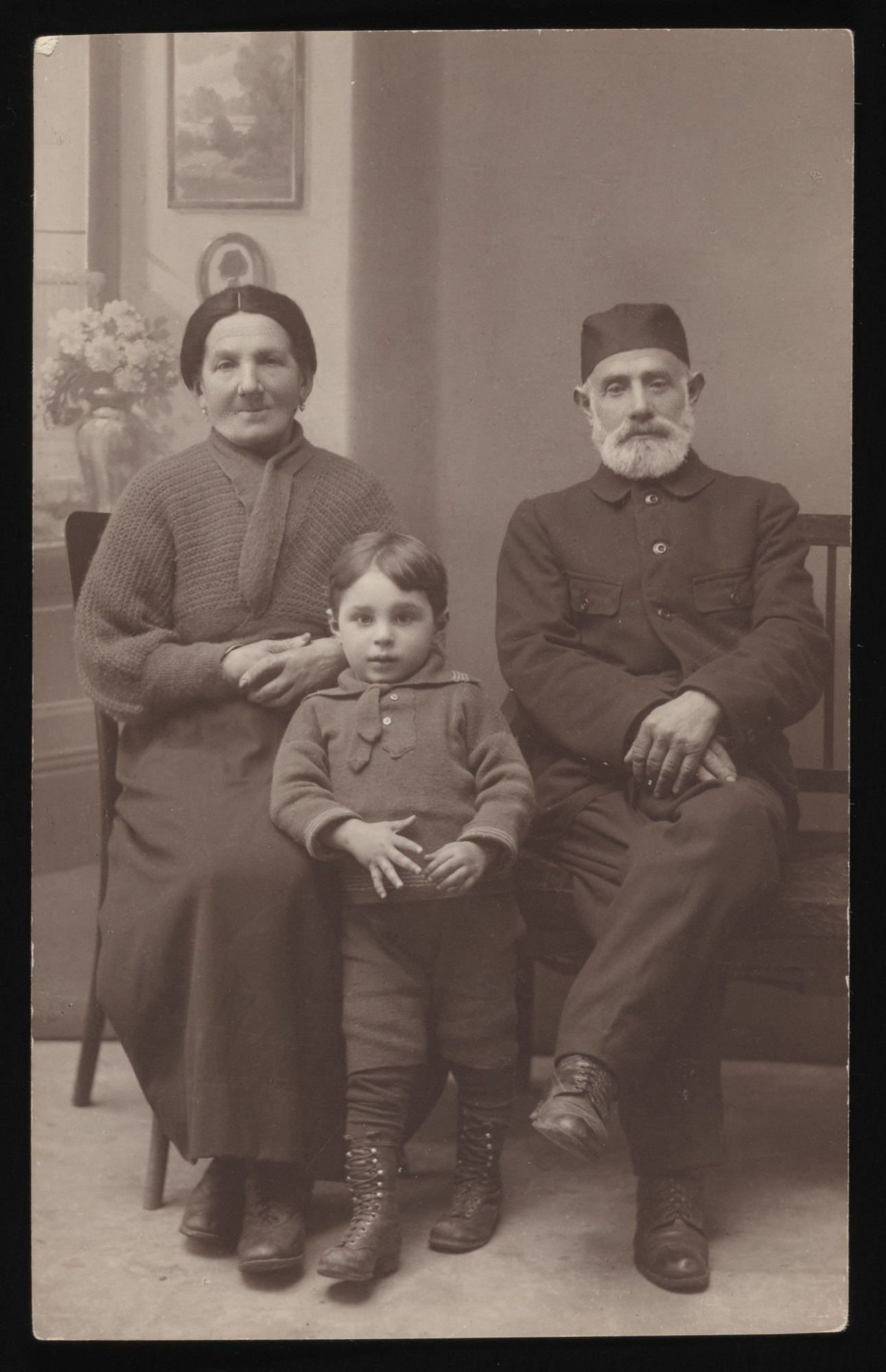 Studio portrait of religious grandparents and their young grandson.  Pictured are Chaim and Szajna Malenka and Elek Arbeiter.