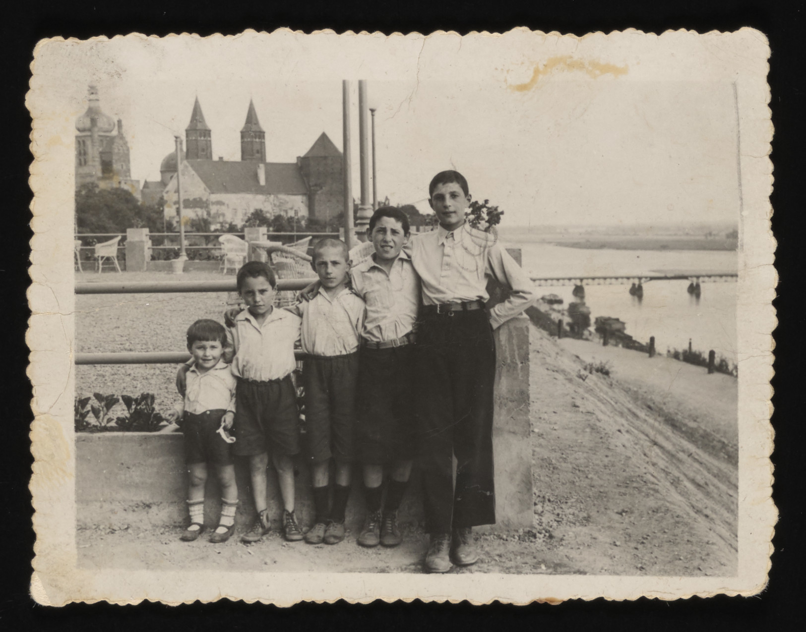 Five brothers pose in a row on the banks of the river in Plock.  Pictured from left to right are Yosef, Aaron, Srulek, Matek, and Elek Arbeiter.