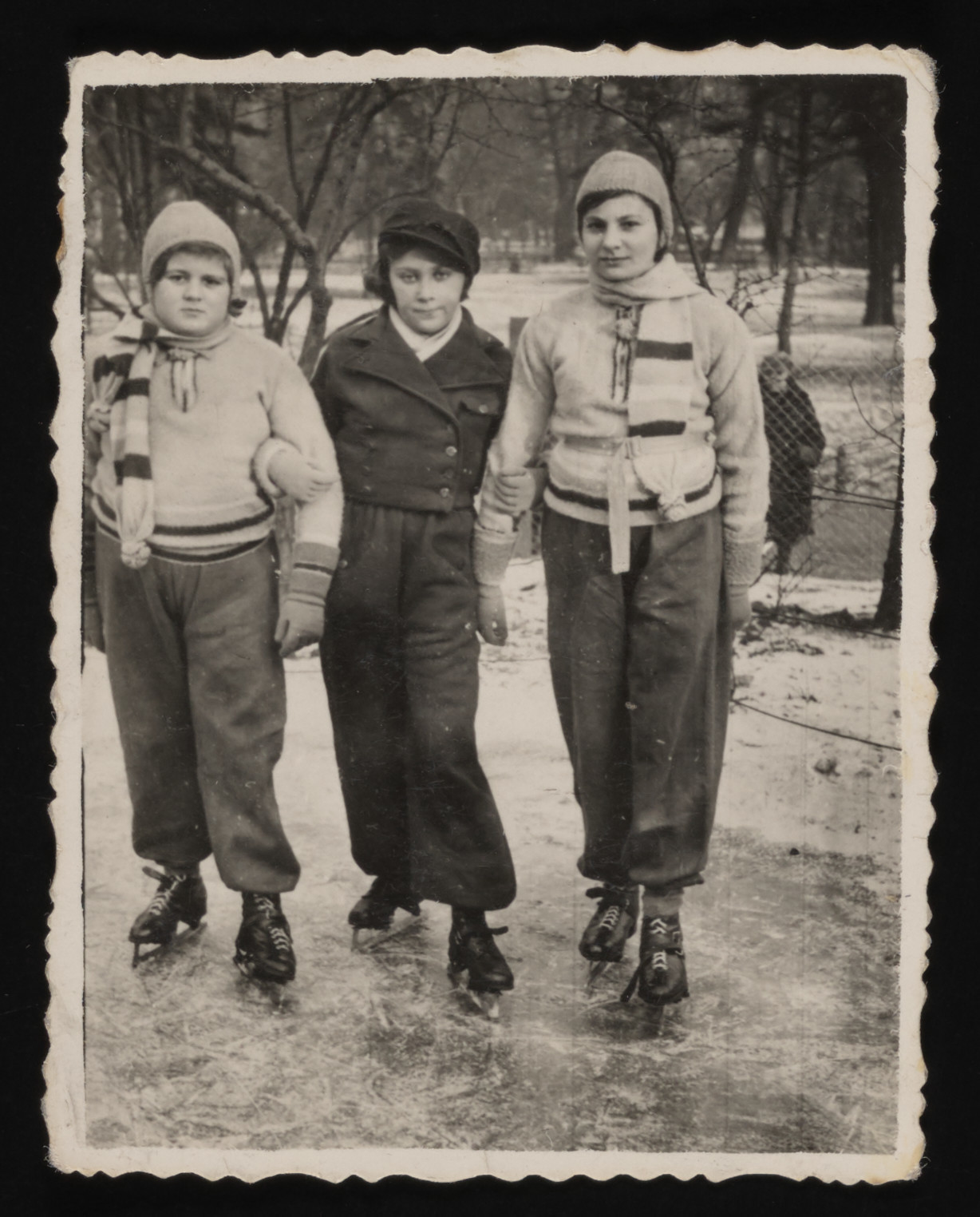 Three Jewish teenagers skate on a pond during their winter vacation in Otwock, Poland.    Pictured from left to right are Ziuta Szczecinska, Zosia Perec, and Gina Szczecinska.  Ziuta and Gina are the donor's cousins and Zosia is her best friend.