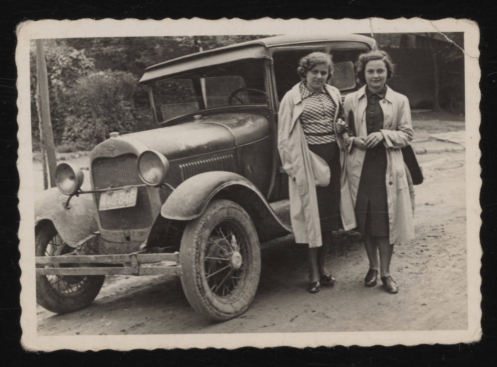 Two young Jewish women pose next to a car in the resort town of Truskawiec.    Pictured are Gina Tabaczynska (right) and her cousin, Ziuta Szczecinska. The cousins attended the same school in Warsaw.