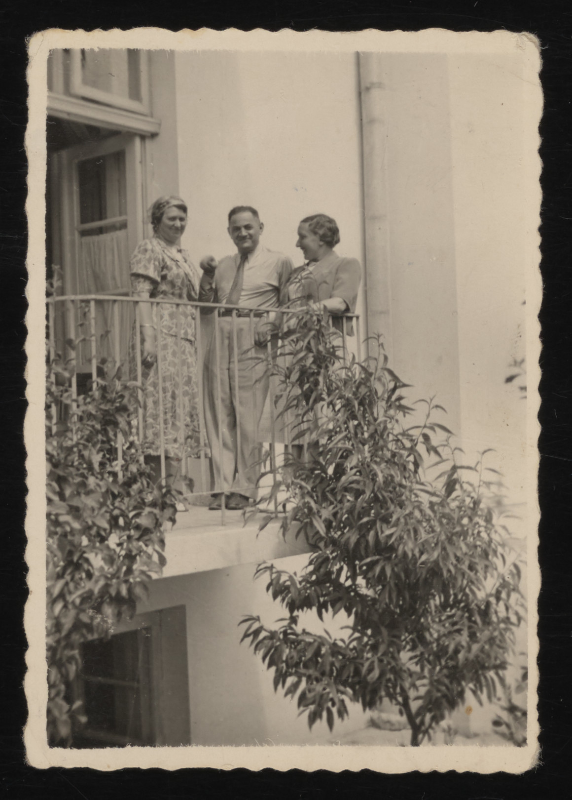 Herman Szczecinski converses with two friends on the balcony of a hotel in the resort town of Truskawiec.  Herman Szczecinski is the uncle of the donor, Gina Tabaczynska.