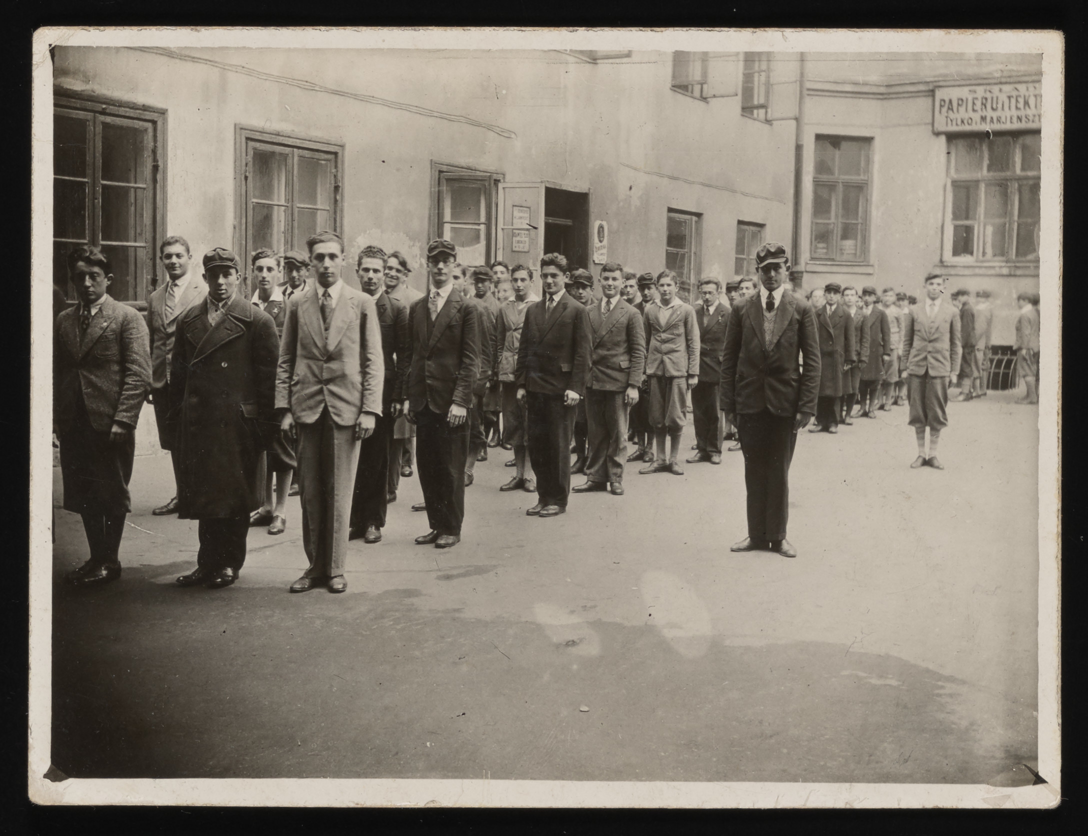 Members of the Maccabi Jewish sports club stand in formation in a courtyard in Warsaw.    Among those pictured is Marek Asz, the future husband of Gina Tabaczynska.