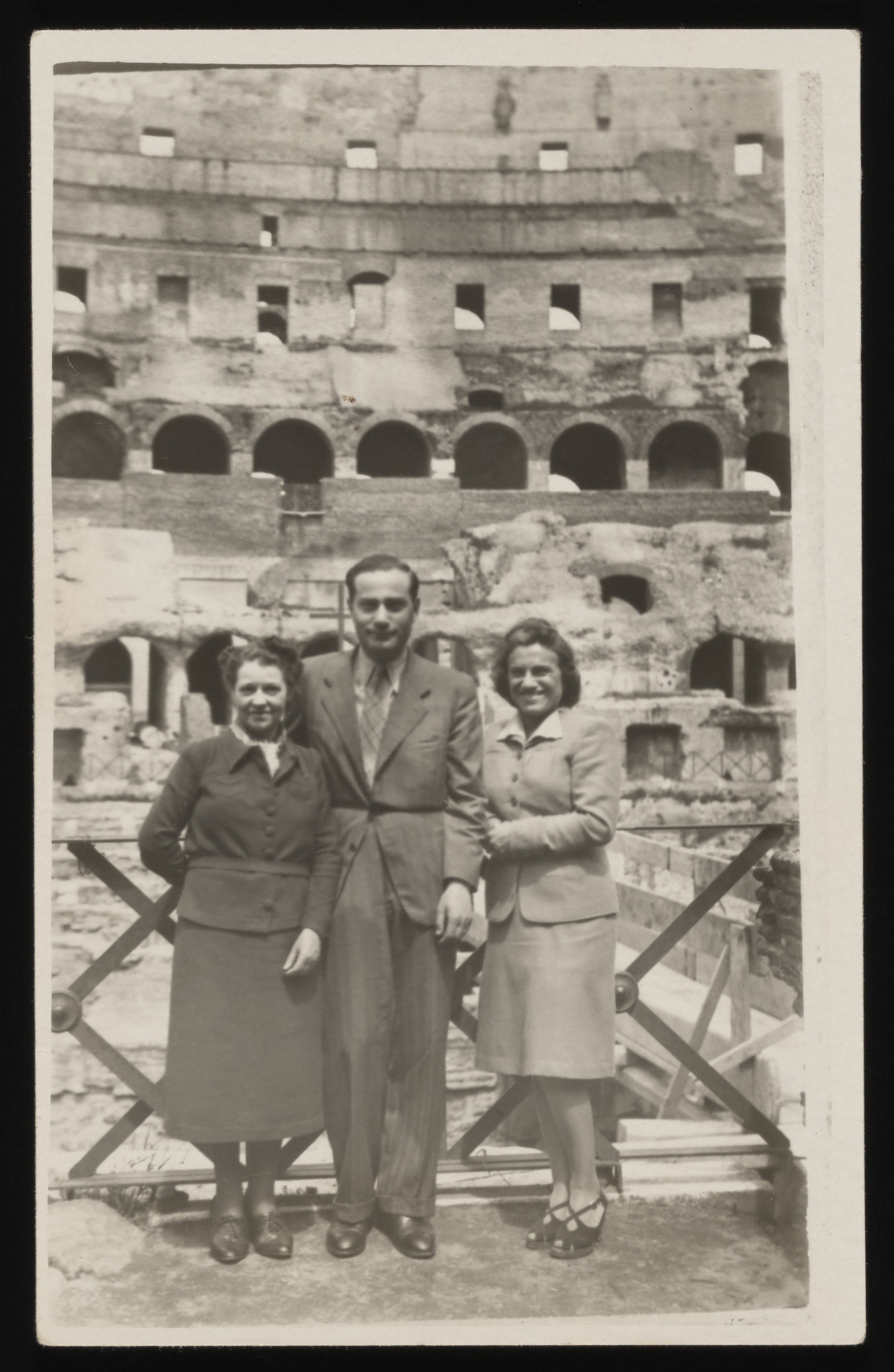 Ittla Gella Asz (left), her son-in-law, Jerzy Szrut and an unidentified woman stand in front of the Colosseum in Rome.