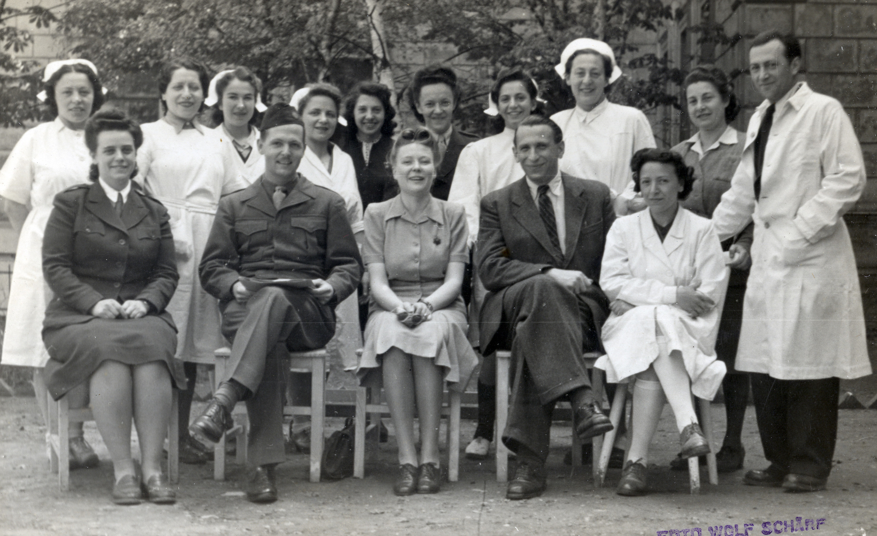 Group portrait of UNRAA staff and medical personnel at the Rothschild Hospital in Vienna.    Among those pictured is Dr. Georg Kollman (seated in front, second from the right).