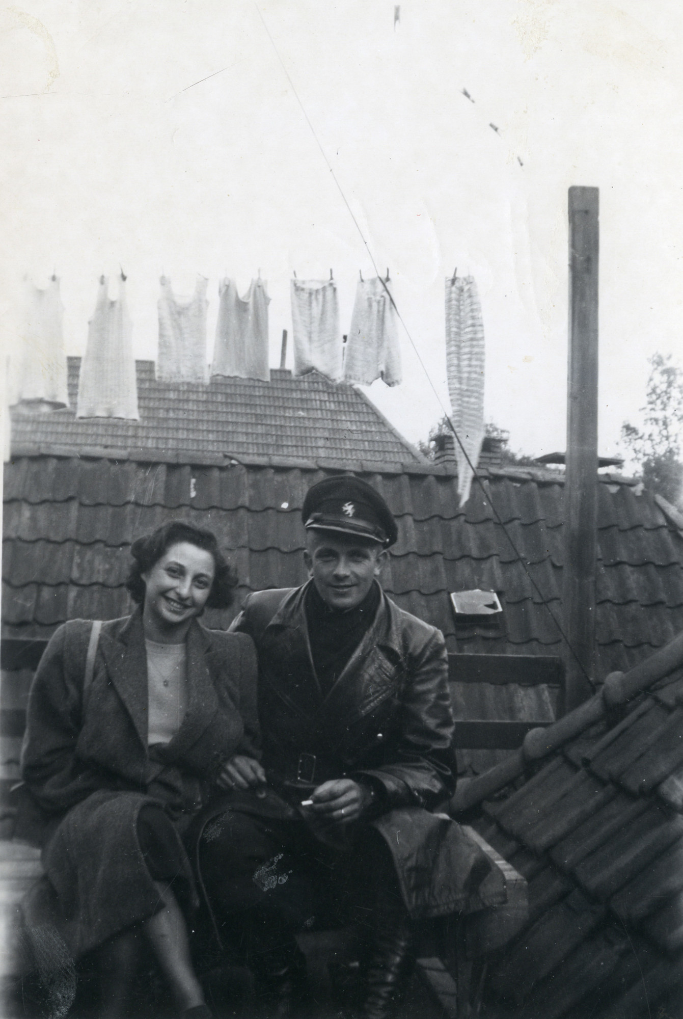 A Dutch Jewish woman poses on a rooftop with one of her wartime rescuers.  Pictured are Erna Stopper (later Bindelglas) and Jelka Rozema.