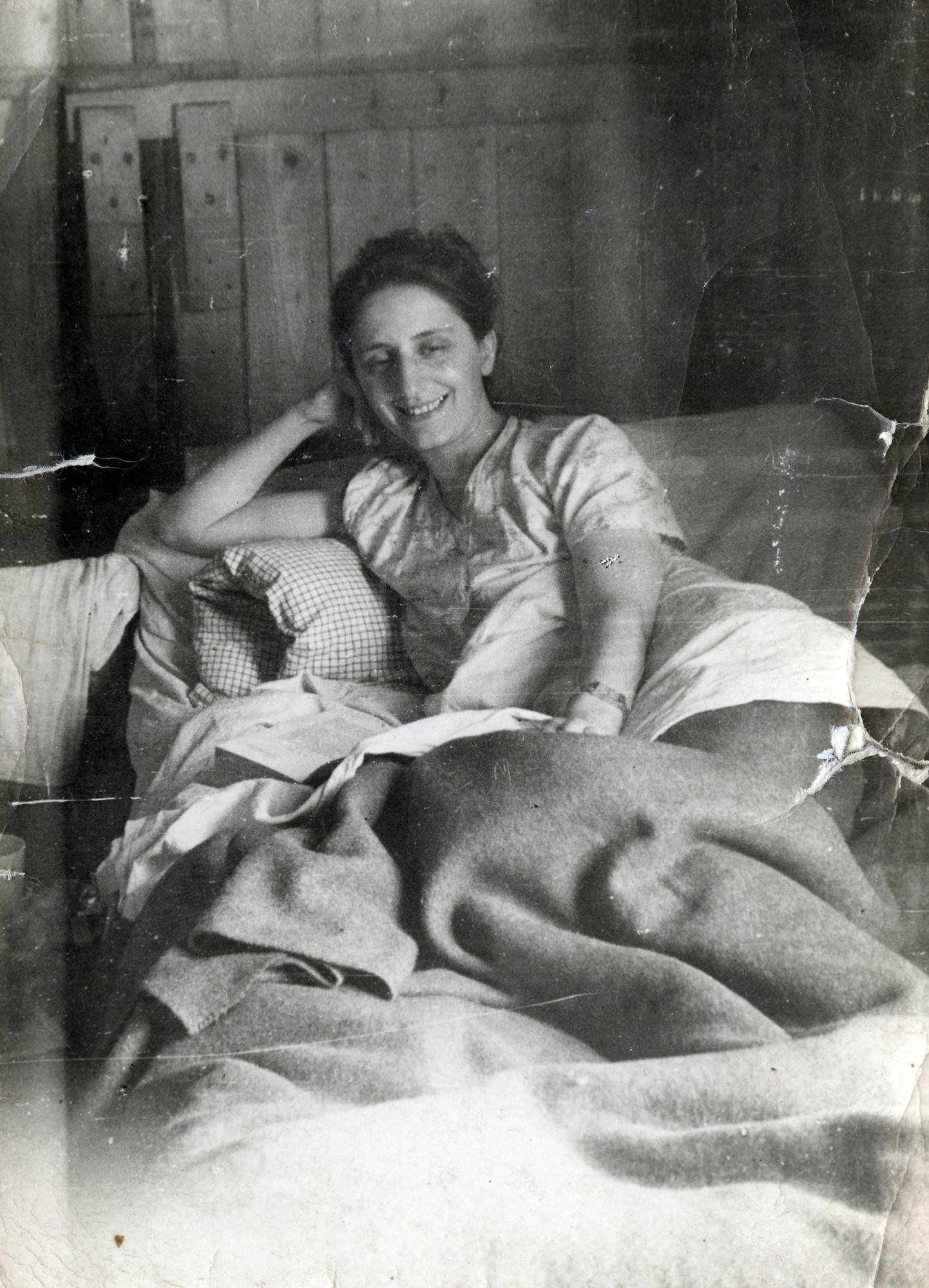 Fanny Marcus relaxes in bed in the Montana refugee camp in Switzerland.