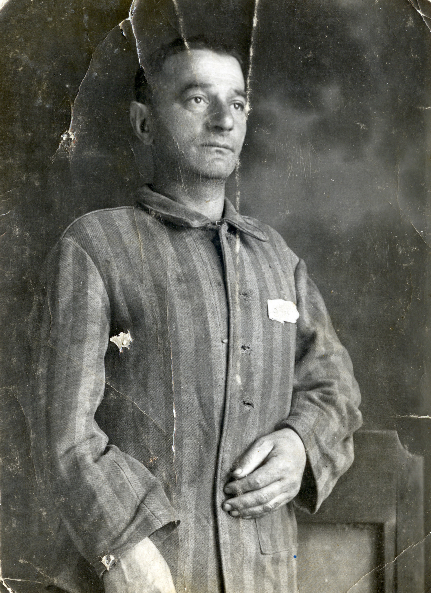 Portrait of Yaakov Michles wearing his prisoner uniform shortly after his liberation from the Dachau concentration camp.