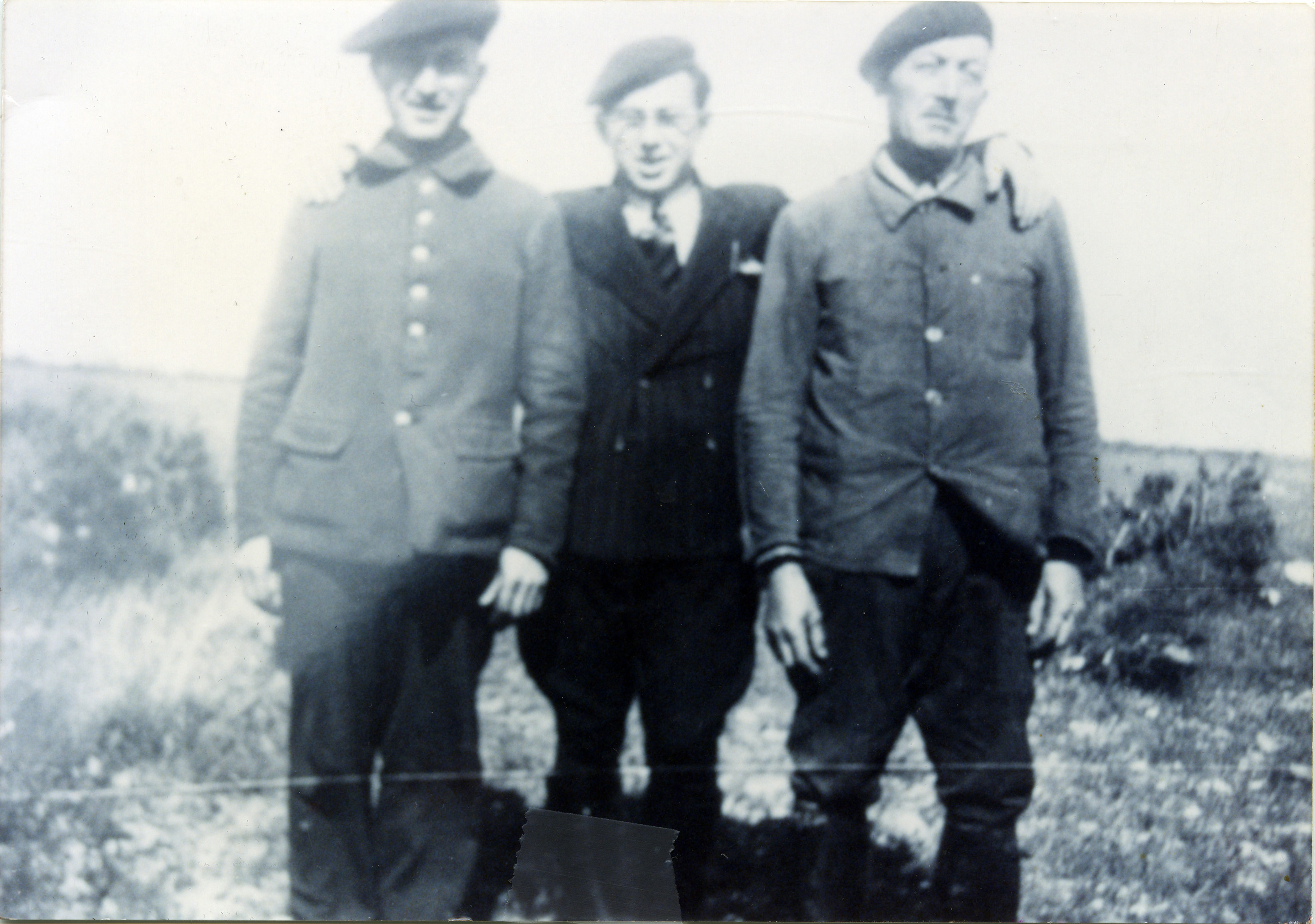 Three Jewish men in the Rivesaltes transit camp.    Pictured on the right is Leopold Judas, with his brother Leo (left) and nephew Erich.  Erich would later be instrumental in helping members of his family escape from Rivesaltes.  All three men were later deported to Auschwitz.