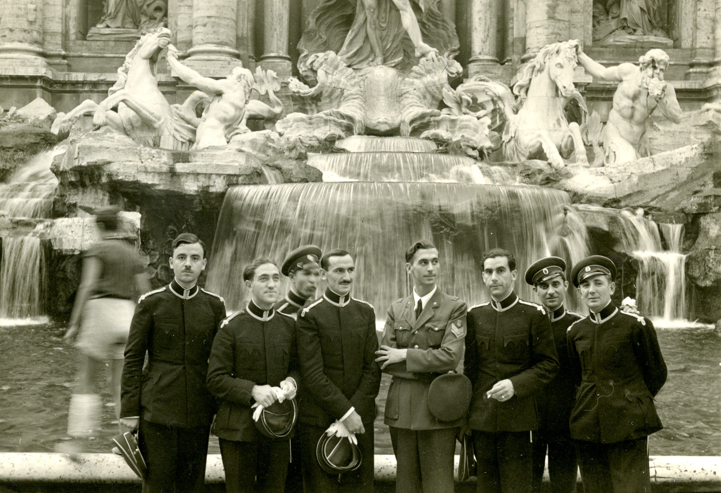 Musicians from the Bulgarian Tsar's symphony orchestra pose in front of the Trevi Fountain in Rome.  Among those pictured is Nissim Alkalay (standing second from the left).  There were three Jewish members of the orchestra:  Nissim, Rafael Sidi, and Jacques Savanov.  All three were expelled from the orchestra upon their return to Bulgaria.