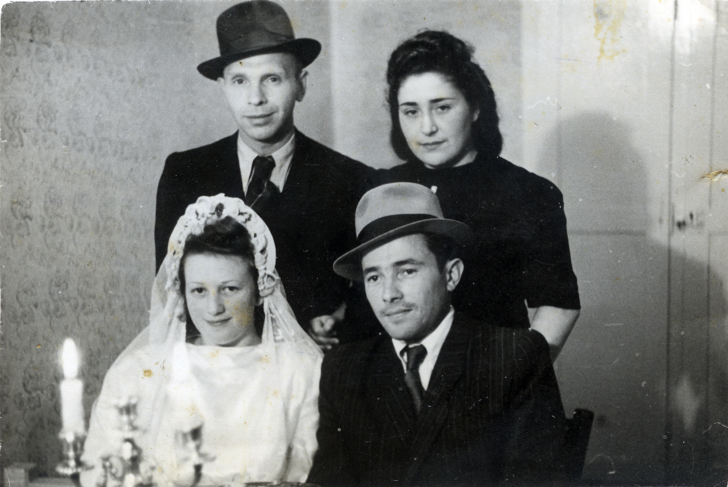 Yehoshua Gold and Shulamit Danishevski attend the wedding of friends [unidentified] in the Dachau displaced persons camp.