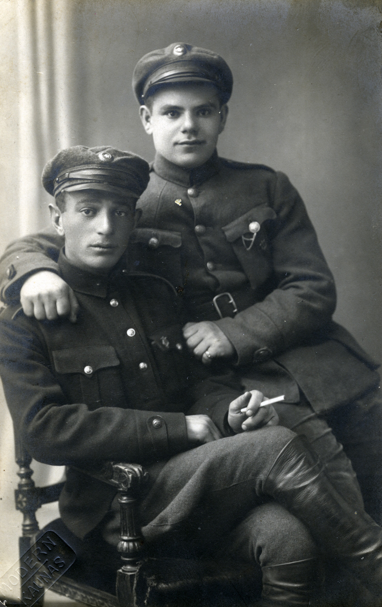 Studio portrait of two Lithuanian Jewish soldiers.   Pictured are Yaakov Michles and Meir Brenner.  Meir immigrated to Palestine in the 1920s.